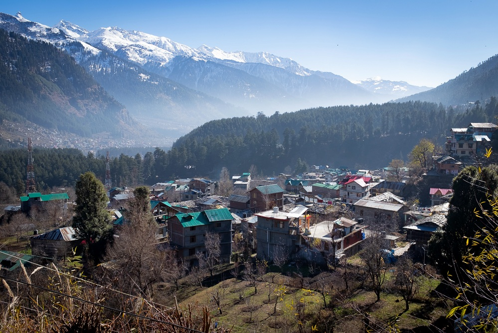 Old Manali, up the hill from the river and surrounded by apple orchards. The smog, caused by traffic and heating, is clearly visible.