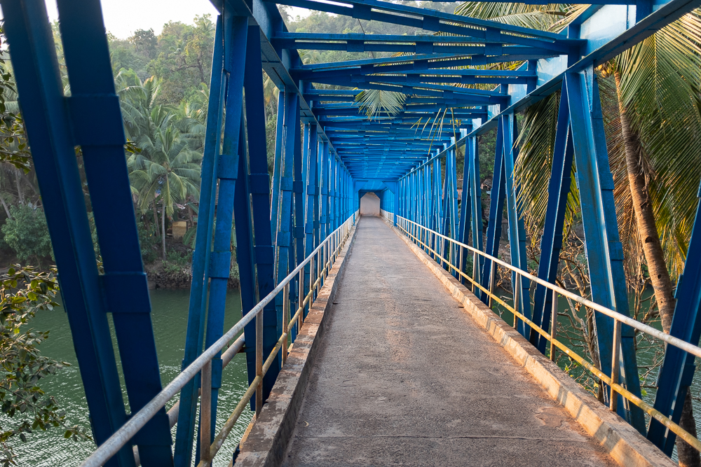 This narrow bridge is yet the only way to cross Talpona river near the coast. Yet.