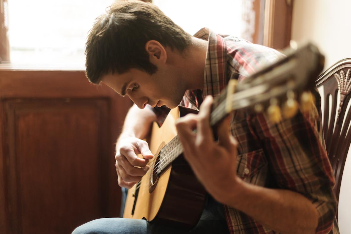 Dude practicing guitar.jpg