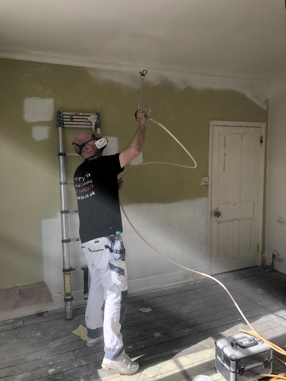 David using the Wagner airless sprayer on a ceiling