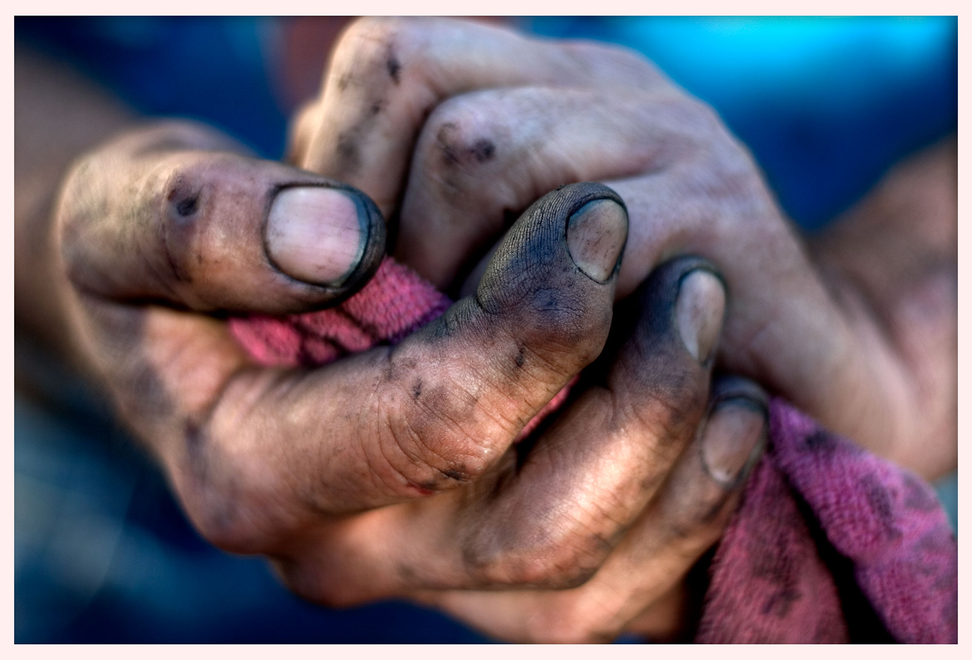 My father's hands after changing a tire. © 2005.
