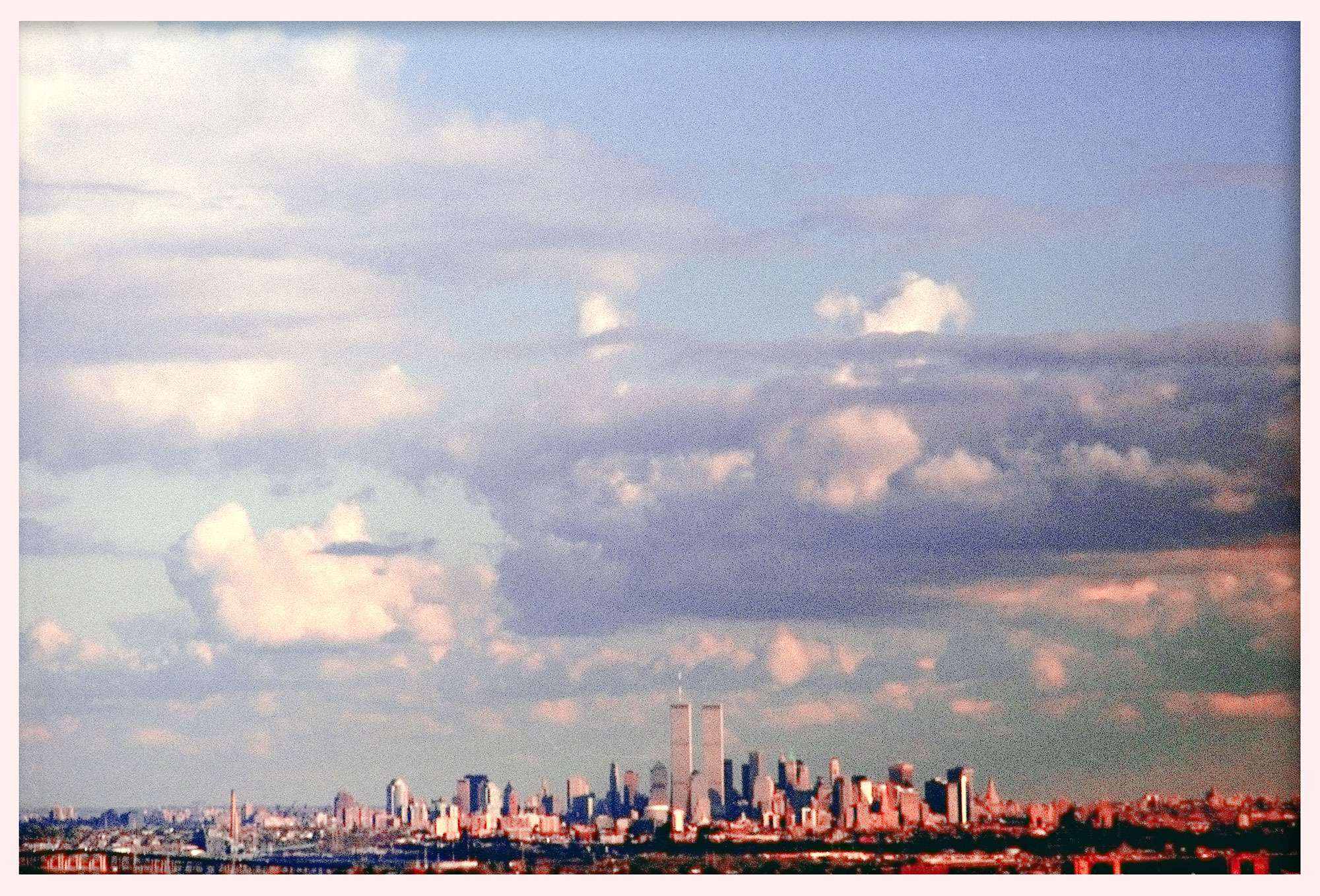 The World Trade Center seen from New Jersey. © 1999.