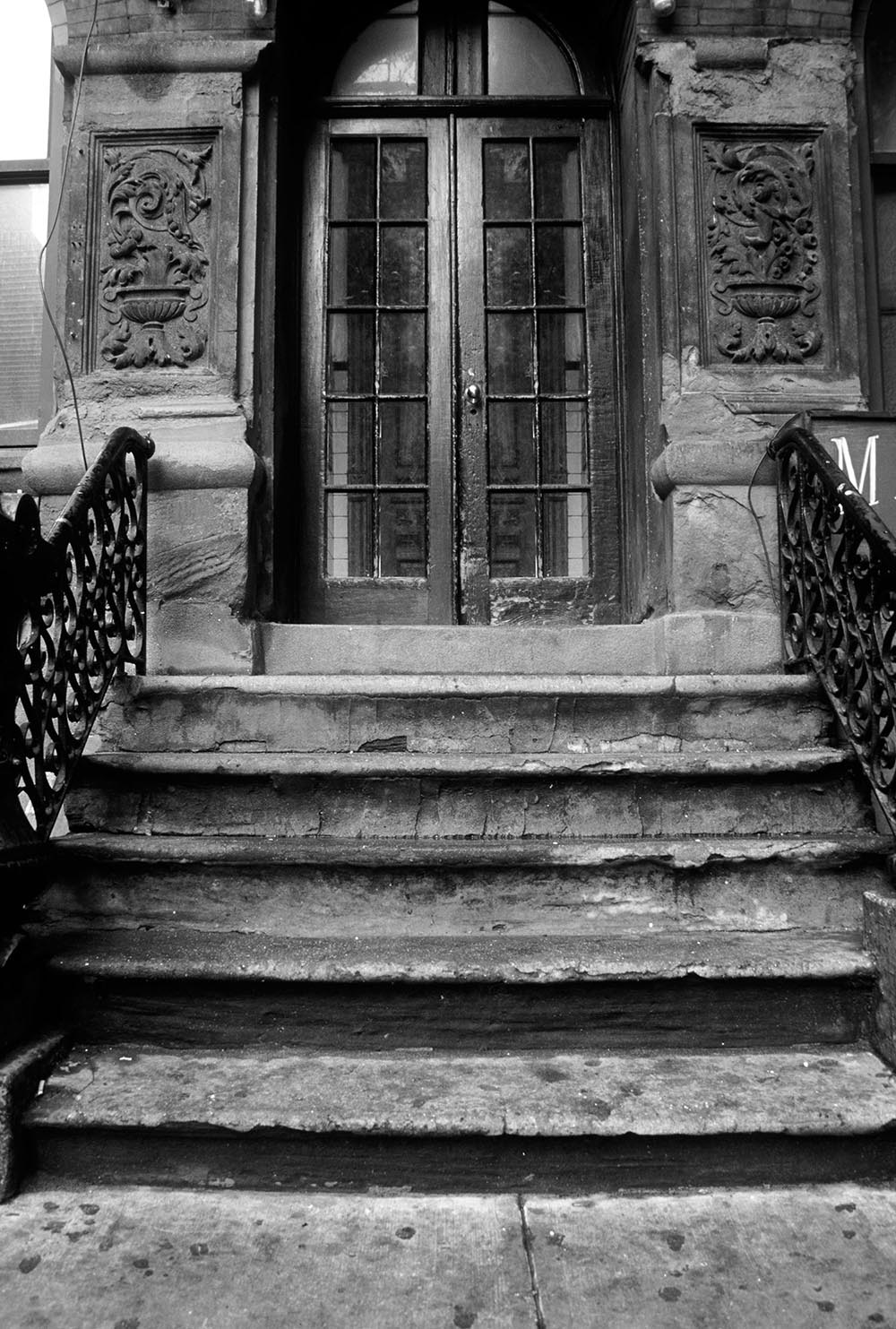 Black and white photograph of a stoop on MacDougal Street.