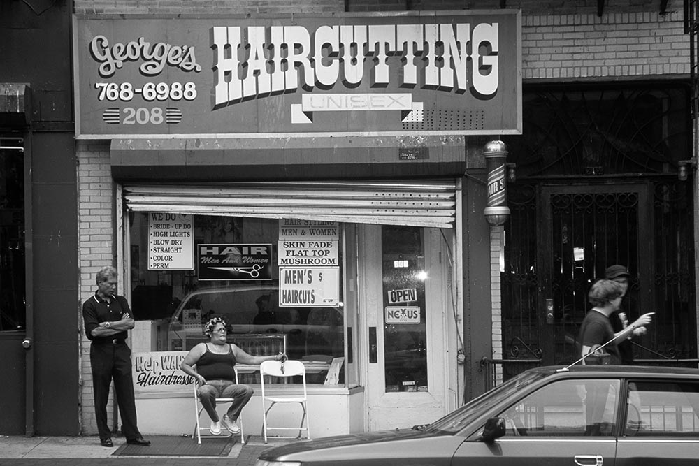 Black and white photo of a barber shop in Park Slope, Brooklyn.