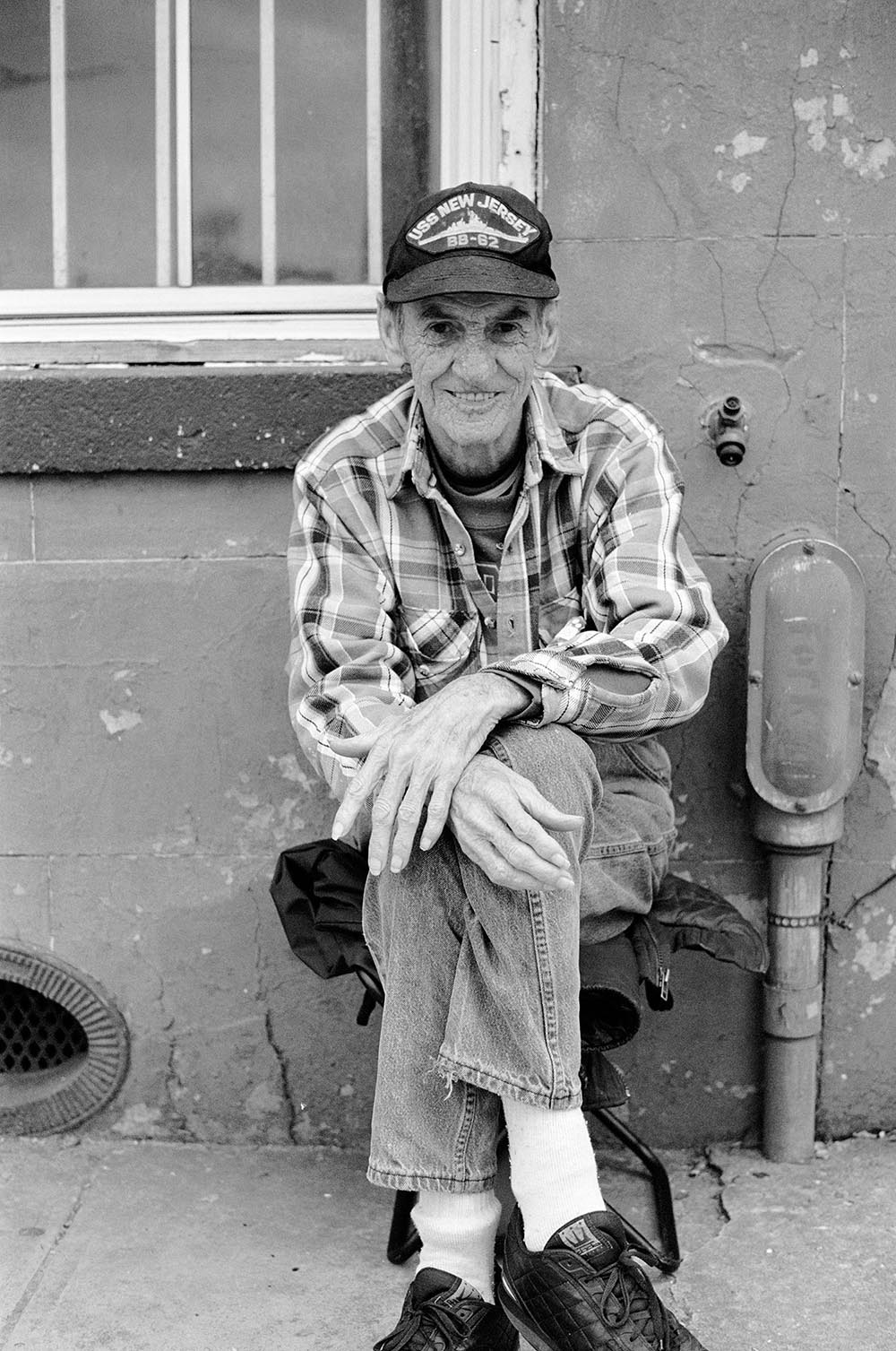 Black and white portrait of a friendly old man.