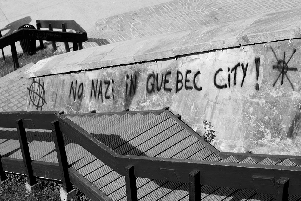 """Black and white photo of graffiti that says """"No Nazi in Quebec City!"""""""