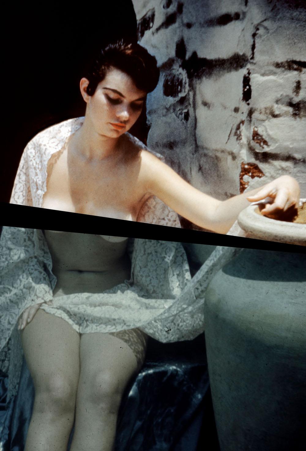 1950s-era amateur nude of a topless woman posing beside an urn.
