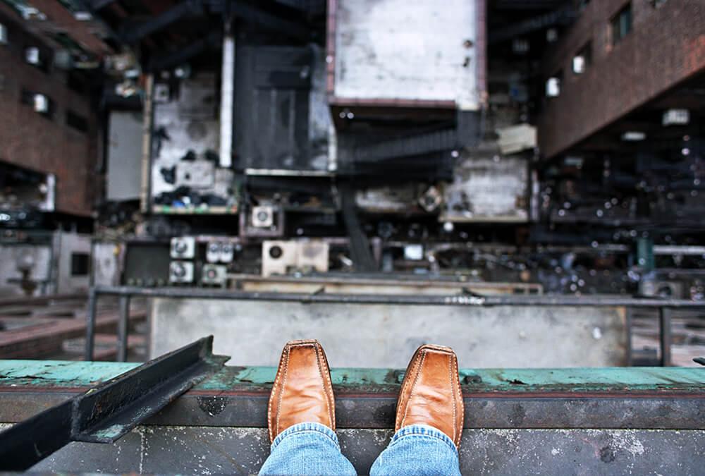 Man on a Ledge Stock Photo by John W. DeFeo
