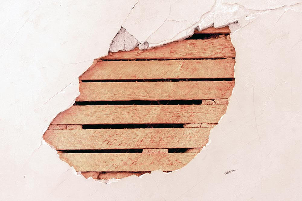 Hole in a Plaster Wall Stock Photo by John W. DeFeo