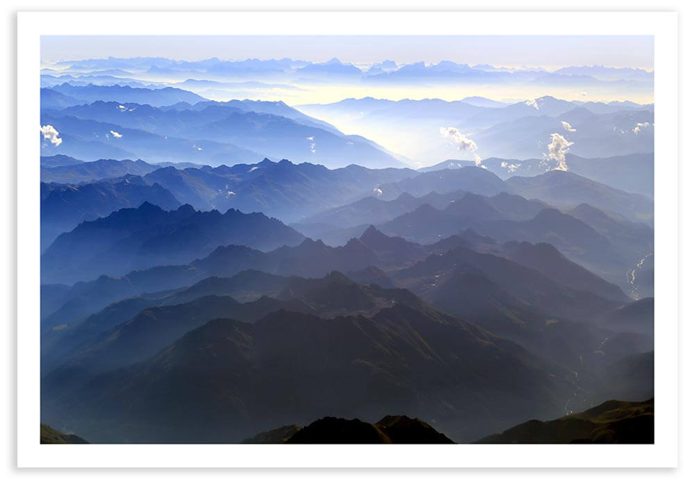 A view of the Bavarian Alps through the window of a small aircraft.  Exif Data: 1/640 sec ; f/8.0 ; ISO 100