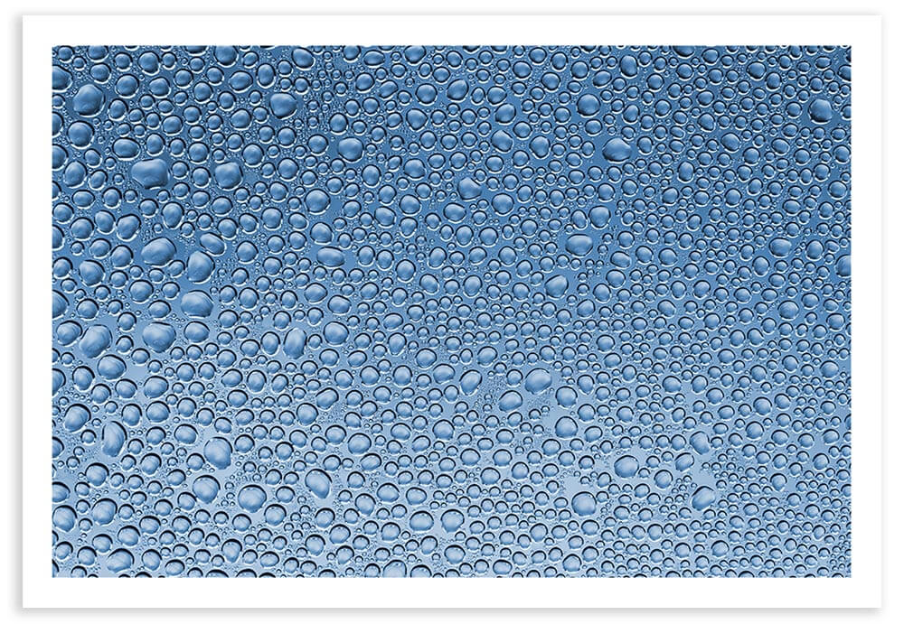 1:1 macro photo of water droplets collected on a piece of cellophane.  Exif Data: 1/5 sec ; f/7.1 ; ISO 100