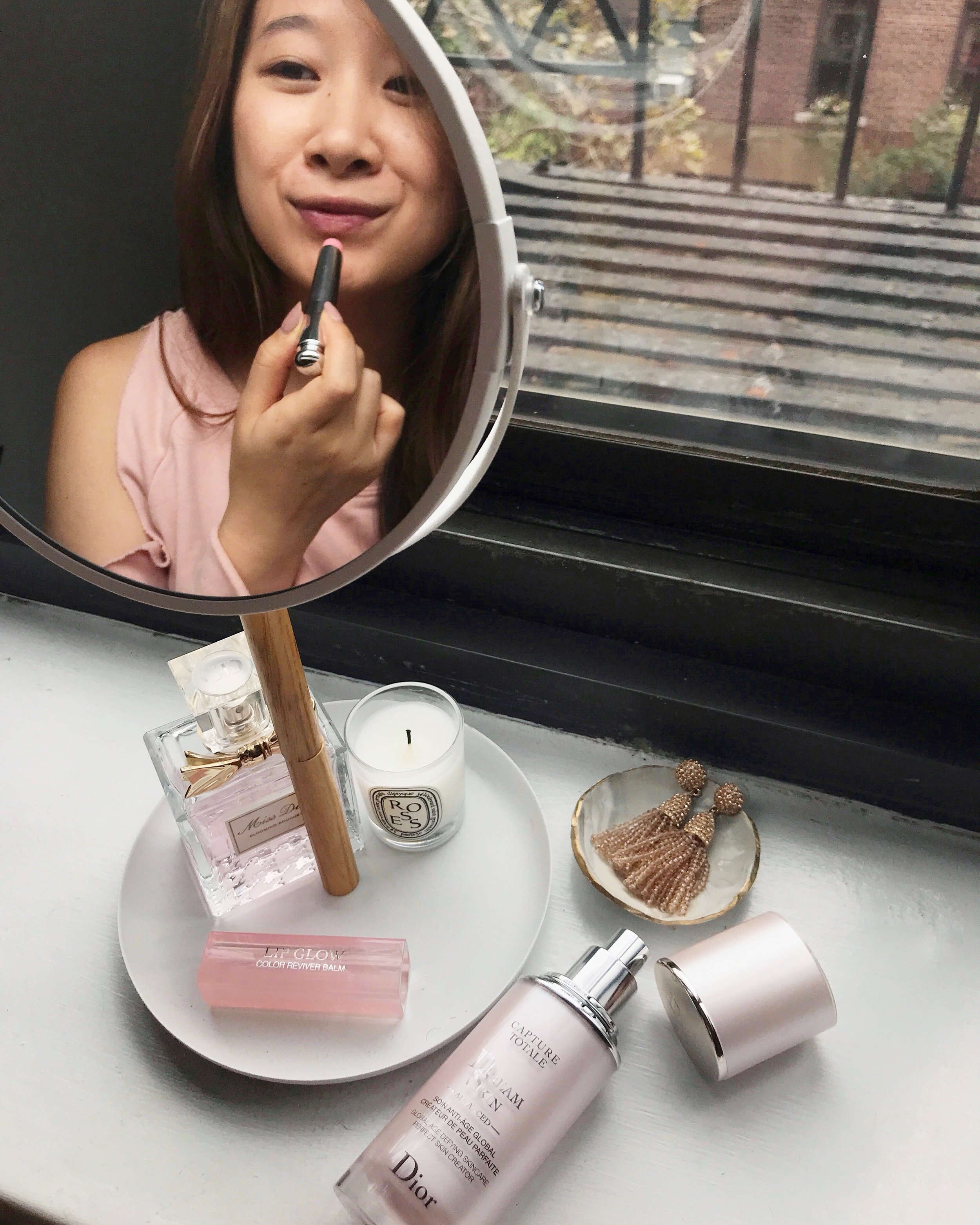 The Lip Glow lip balm by Dior keeps my lips moisturized throughout the day and gives me a healthy-looking lip color.