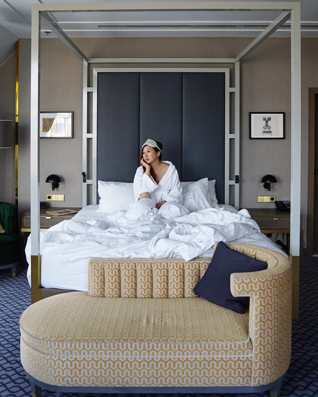 Enjoying the comfort of the bed in Hilton Vienna Plaza's Junior corner suite.