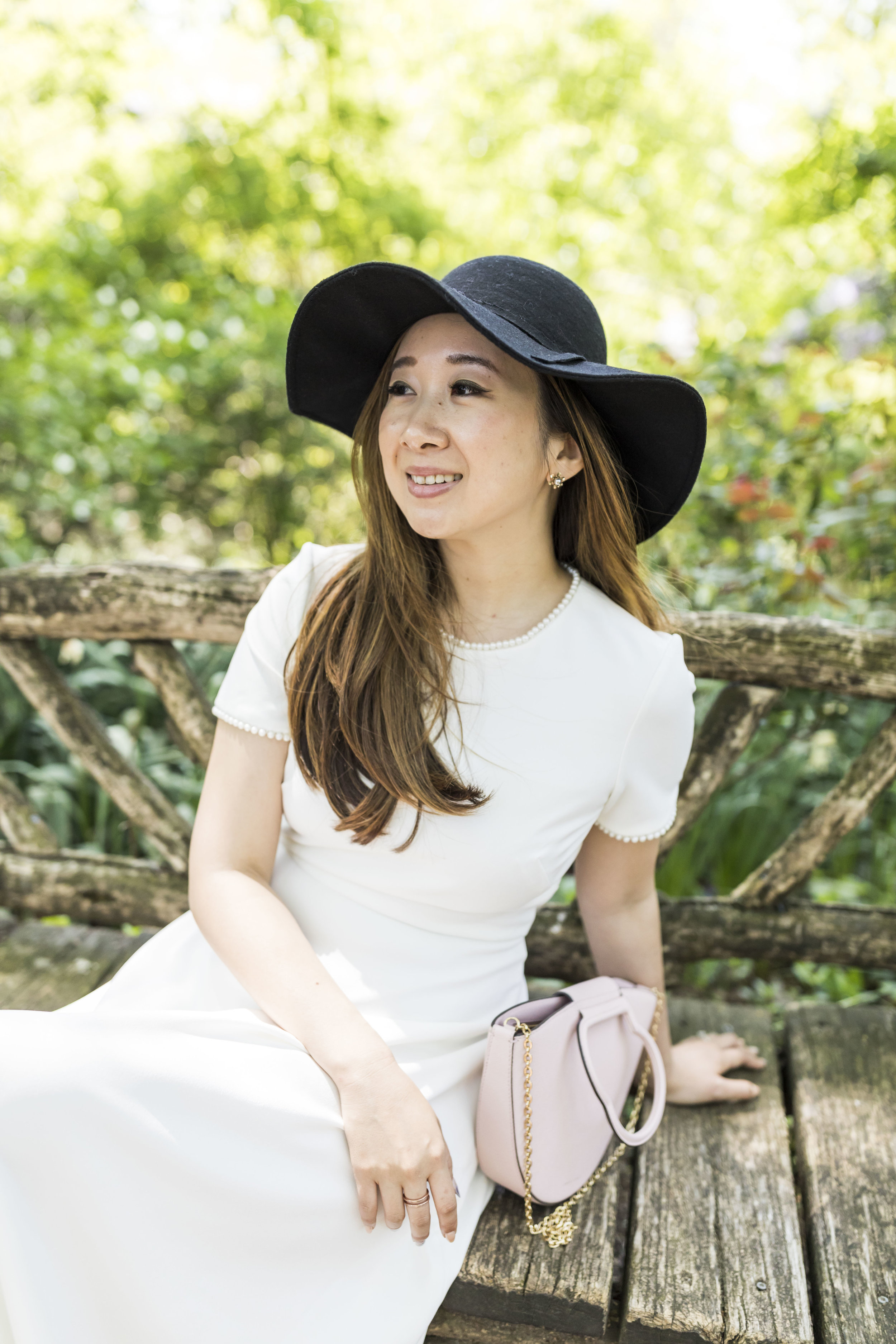 You can never go wrong with a simple black and white combination, #AmIRight?This white dress is a classic and in one of my favorite fit-and-flare styles.  Hat: Asos (Similar  here ); Dress:  Gal Meets Glam ; Bag:  Danse Lente .
