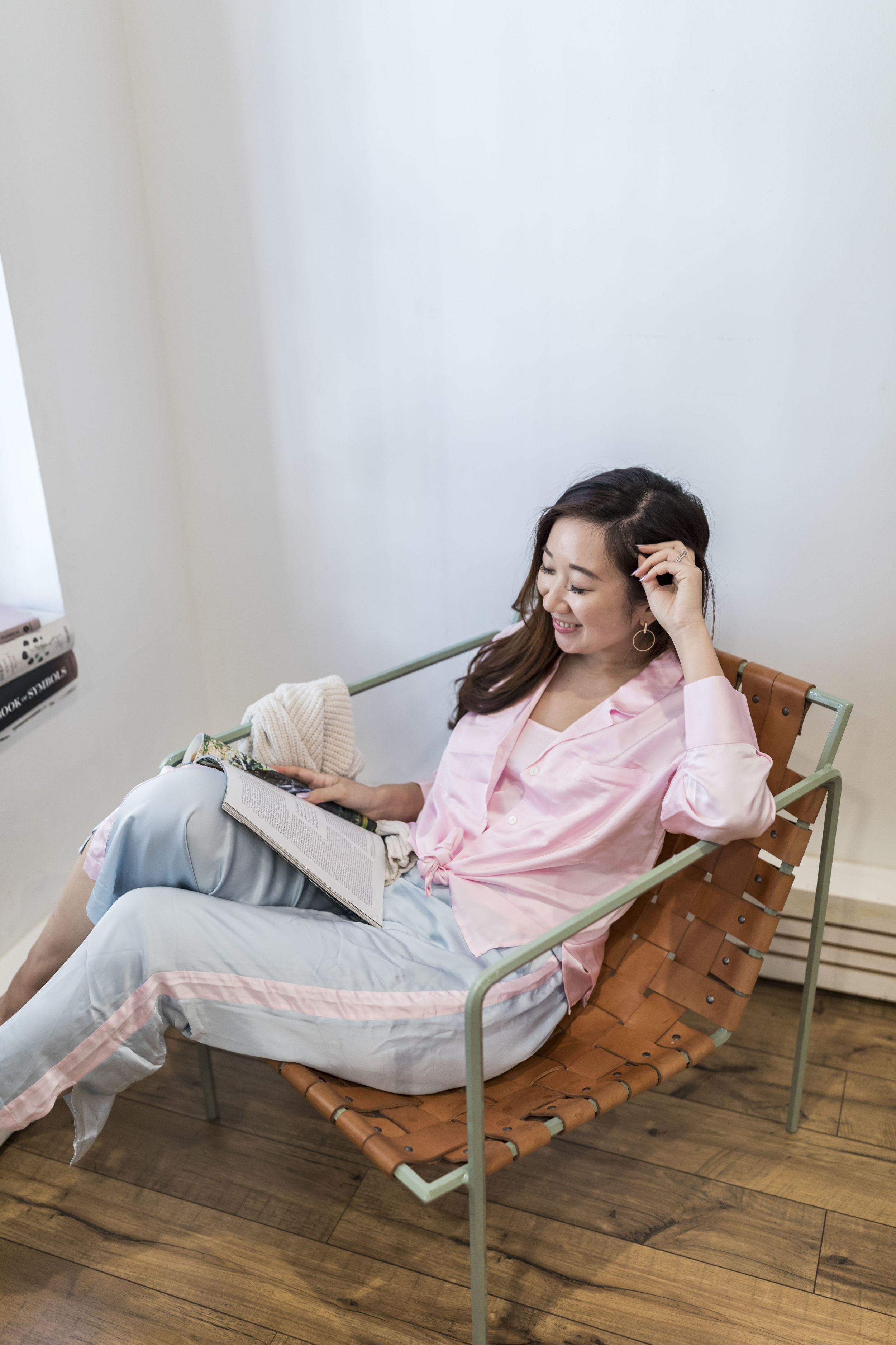"""Chilling at Home - What I wear often determines how I feel. So I do find myself to be less efficient and a bit lazier when I'm in my oversized, 10-year-old """"distressed"""" t-shirt and my dad's old shorts that was passed down to me because it shrunk in the dryer once.I've always wanted to wear chic, adorable sleepwear, but often find them either really expensive (and requires high maintenance), or really cheap and low quality. No Plans NYC is likely the first sleepwear brand that I've recently came across, offering stylish, quality pieces at a reasonable price.And the best part is: I can leave the house and show off the pieces, too!—Photos by Ashley Gallerani Photography."""