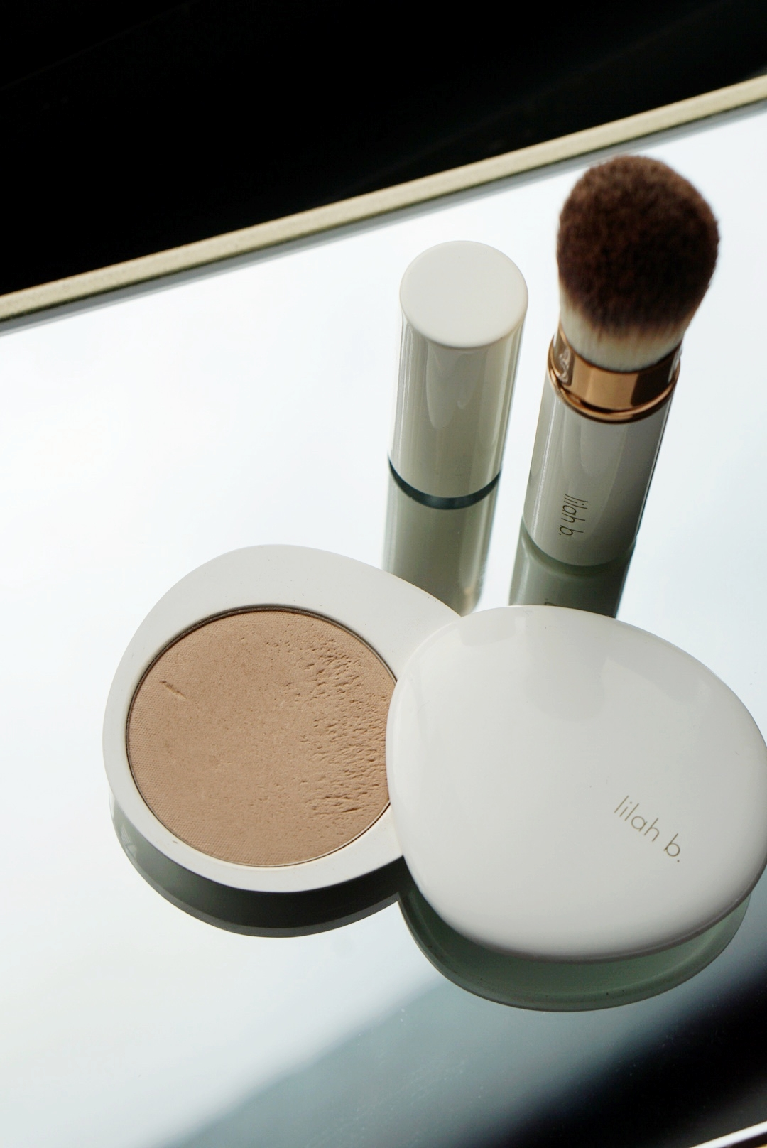 Flawless Finish Foundation by lilah b. - This foundation is in a powder formulation that offers light coverage. It is designed to work with any skin type and formulated with natural ingredients such as aloe and agar for hydrating benefits. It also has coconut oil! The shade I have is called b. natural.What I love: The powder has a build-able formula and instead of caking your skin, it makes you feel like you're not wearing makeup at all. I find this product perfect for controlling the shine on my oily t-zone. I also love the packaging!What I'd like to change: The brush feels a little harsh against my skin sometimes, so I actually swapped it out for a brush that feels softer after a few use.