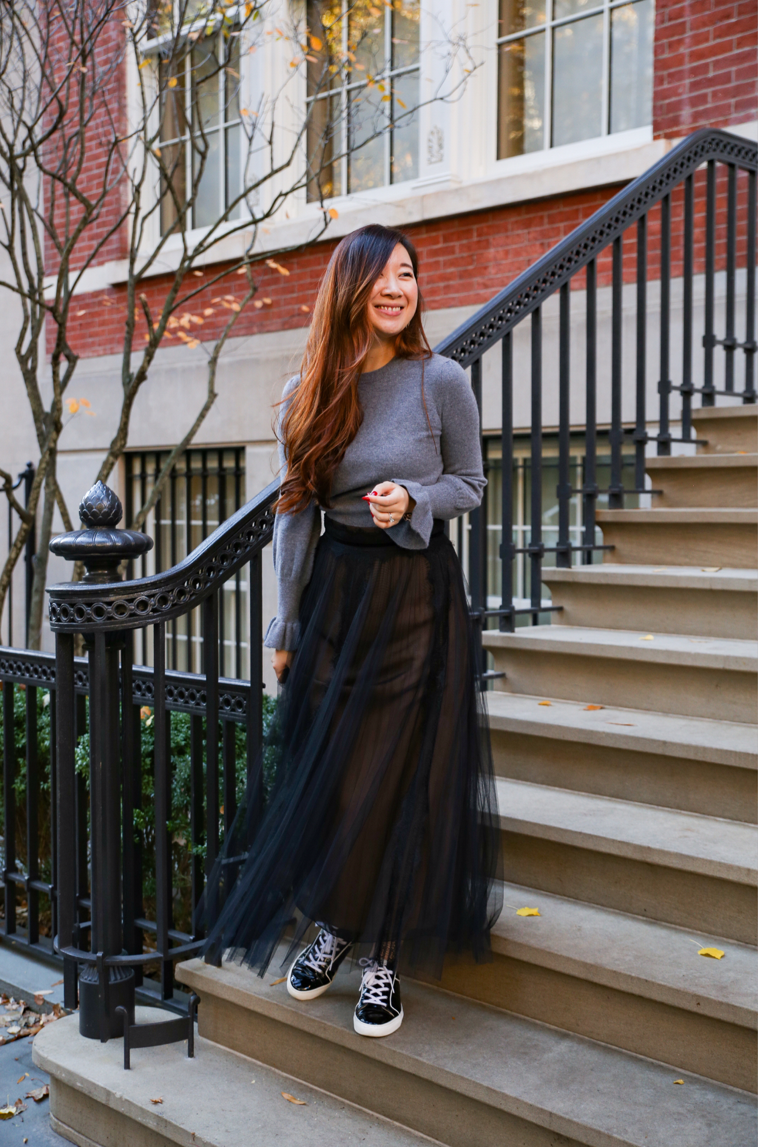 Yes to Tulle! - I love tulle skirts! And I think wearing this black one with the sweater makes a great outfit for a semi-casual date night or just brunch with the girls on the weekend!I paired the whole look with sneakers for that reason, to keep the overall look a bit more casual!Photo by Wini via The Laurel Creative Team.