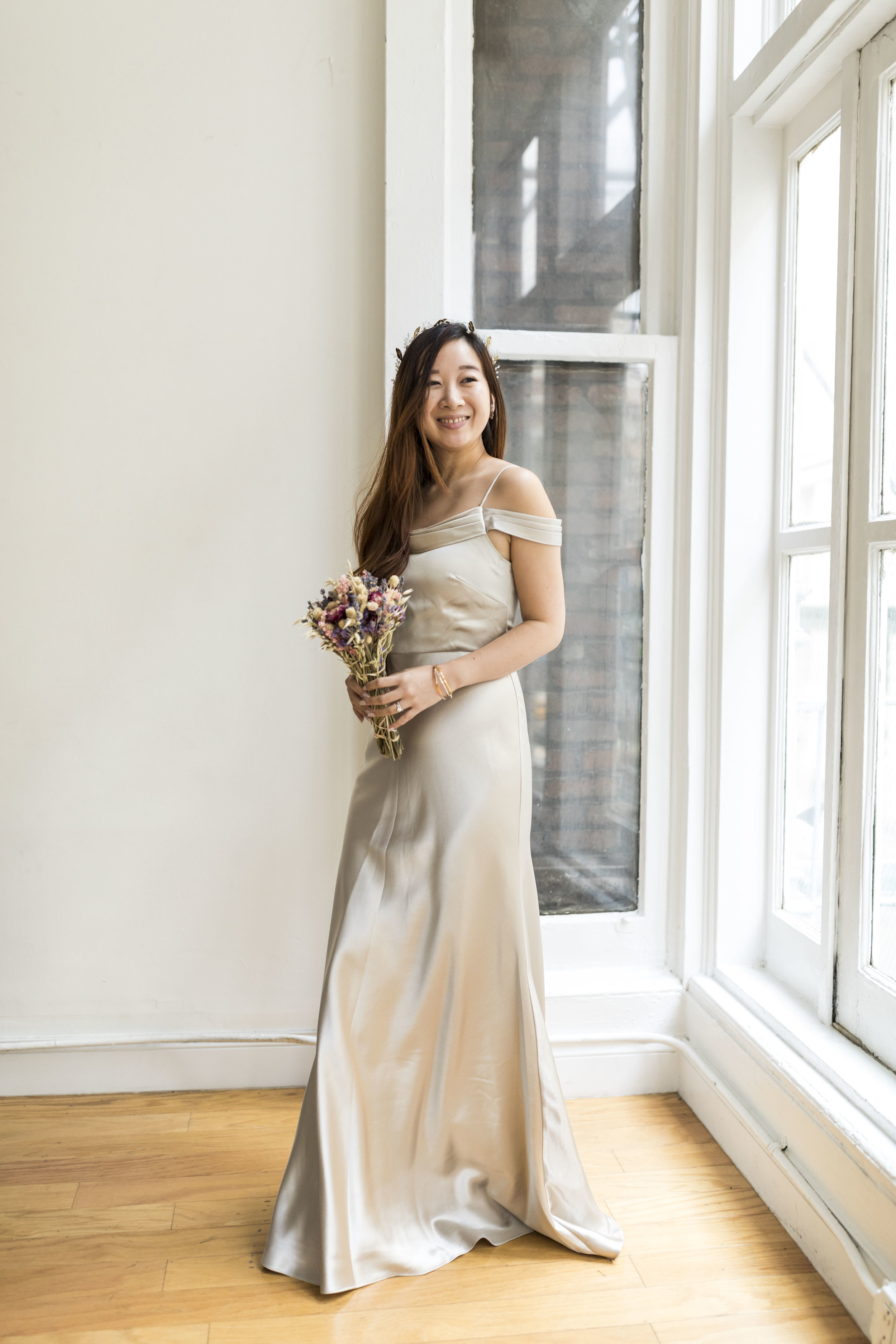 This Jenny Yoo satin gown features a fluid A-line design. Photos by Ashley Gallerani.