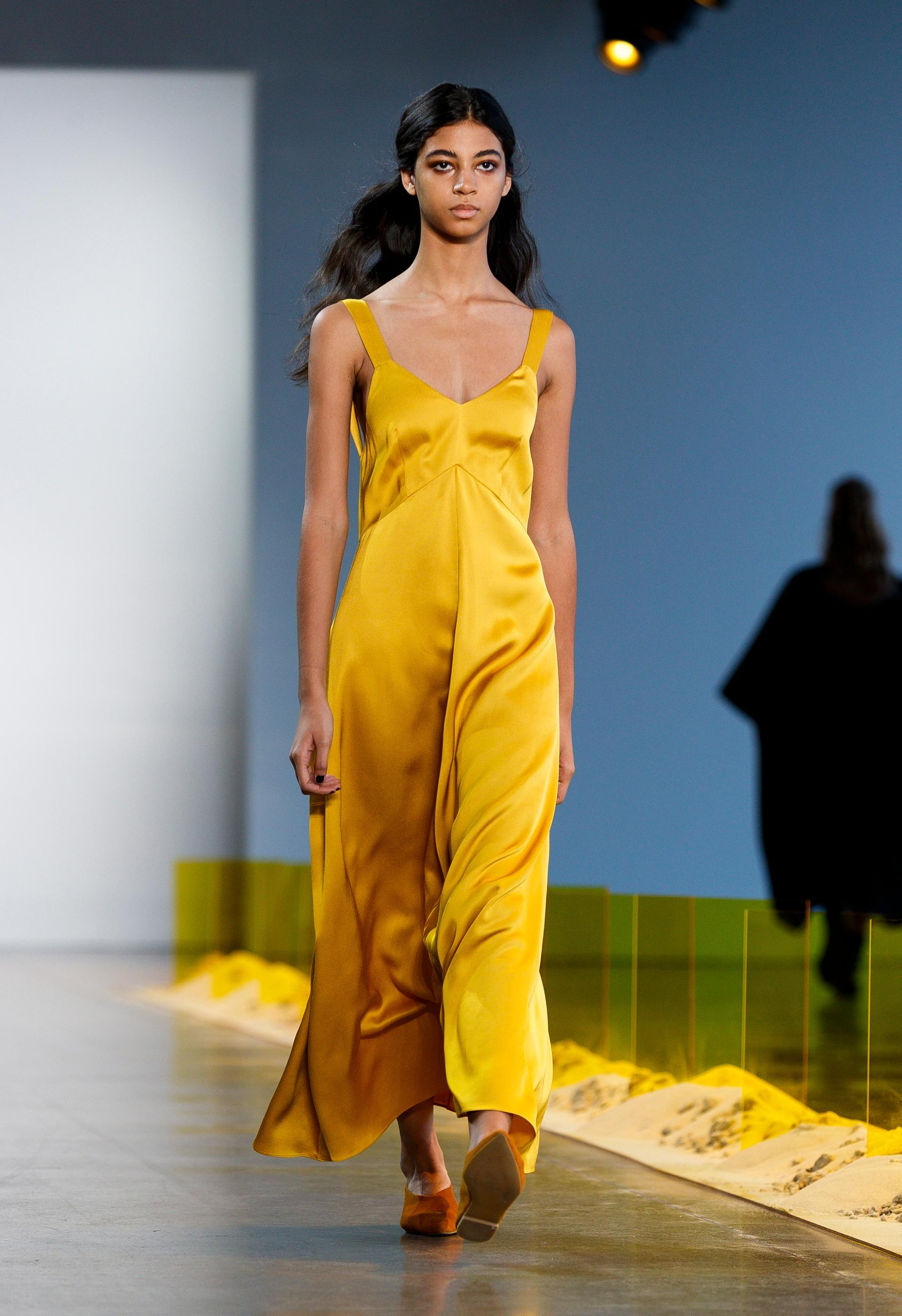 Noon by Noor featured flowy pieces with solid colors. This yellow maxi silk dress is one of my favorite looks from the collection. Photo credit: The National.