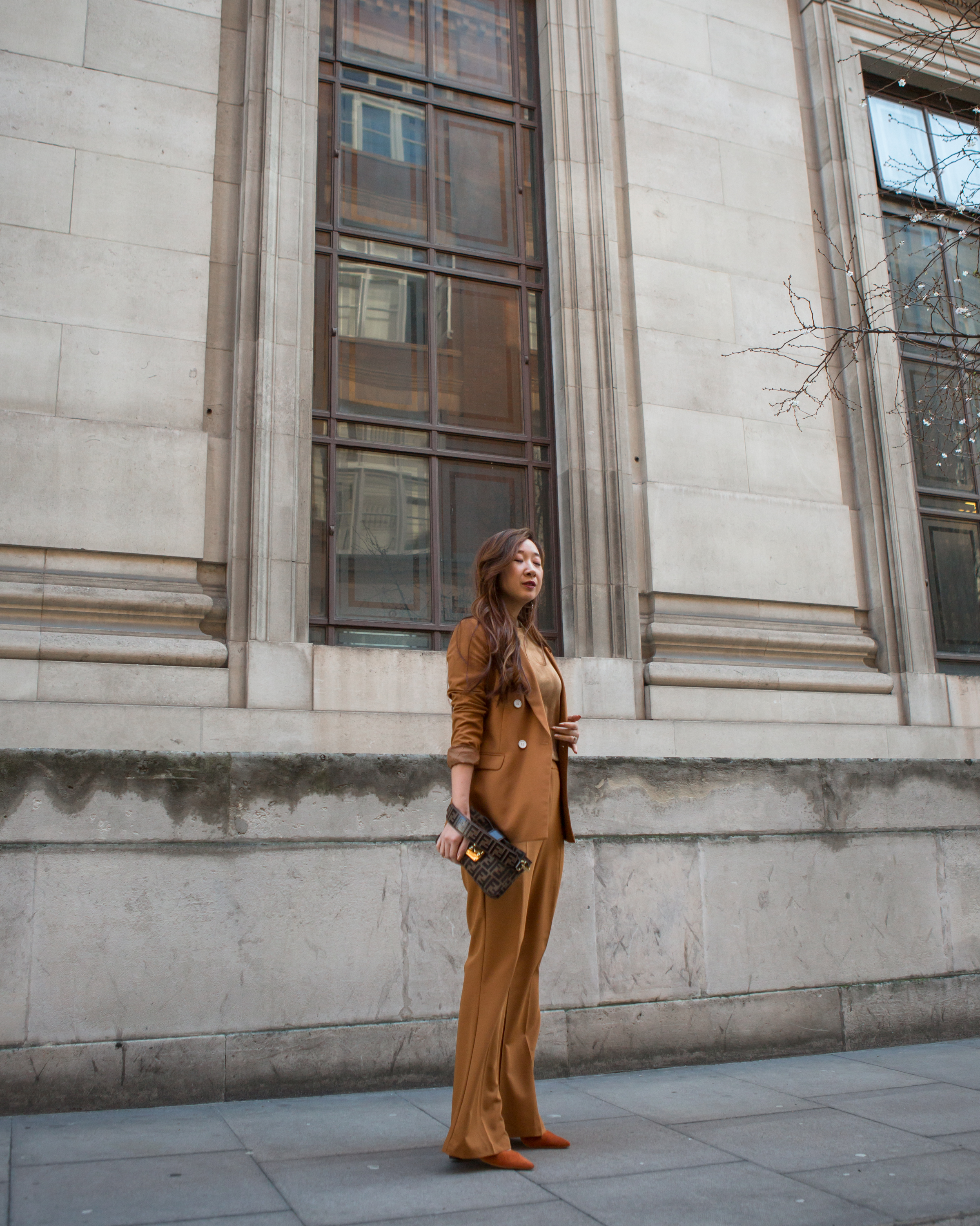 For the first presentation, I wore a head-to-toe camel-toned outfit, featuring a suit and a velvet top, as well as my burn orange suede heels from Jacquemus. Photos by  @lucy_aliceb .