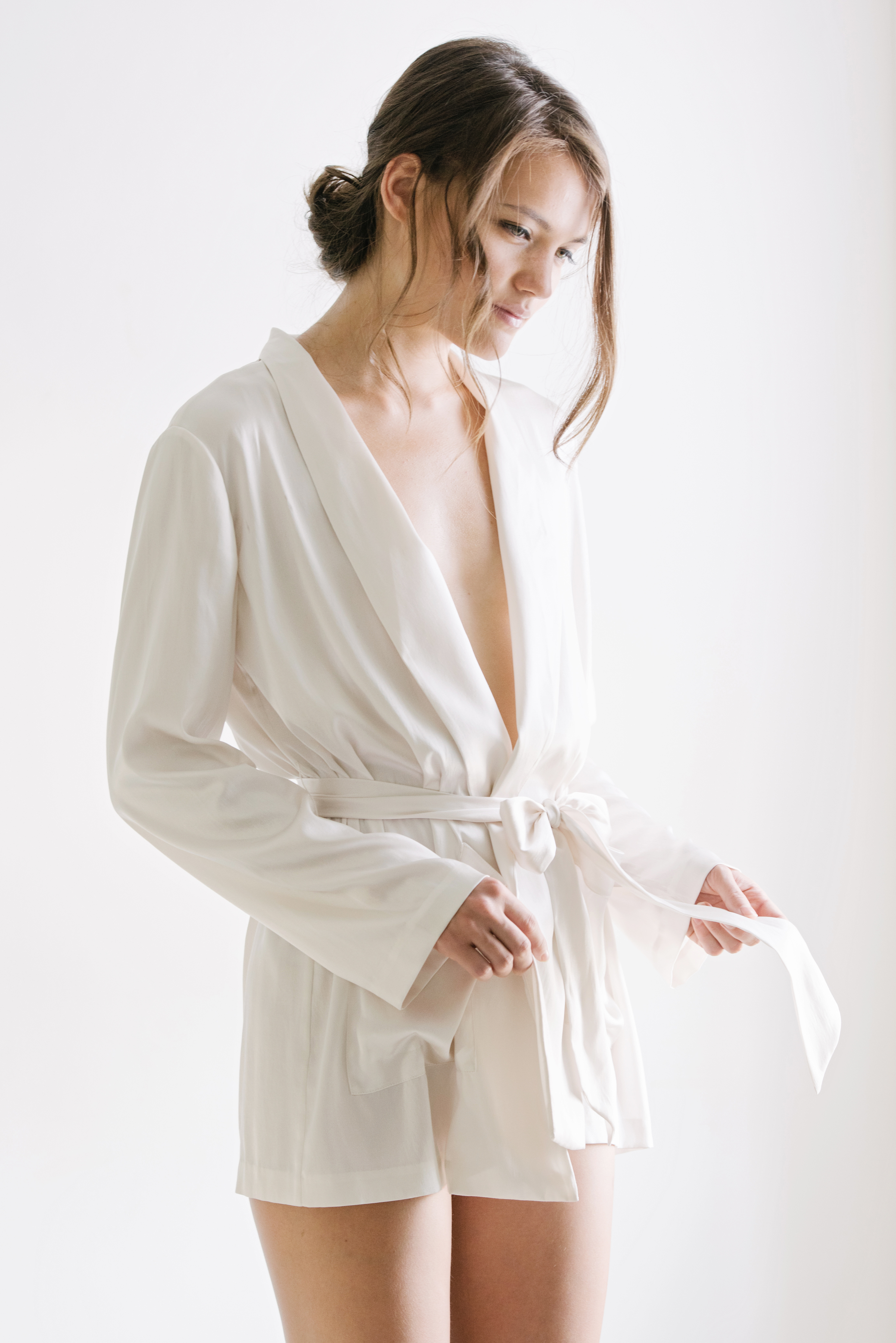 "Nusa Silk Robe by MaggieWu Studio - This silk robe is a great choice for new moms because not only would they feel so comfortable wearing it this summer, they will look presentable when people come by the house to visit. Plus, it's very easy to ""unwrap"" and open when it's time to breast feed the little hungry one!Later on, this robe can be styled for various occasions, making it a very versatile piece! You can click here to check out how I styled the robe in 7 different ways!You can also personalize the robe by adding initials, too.Photo: Courtesy of Maggie Wu Studio."