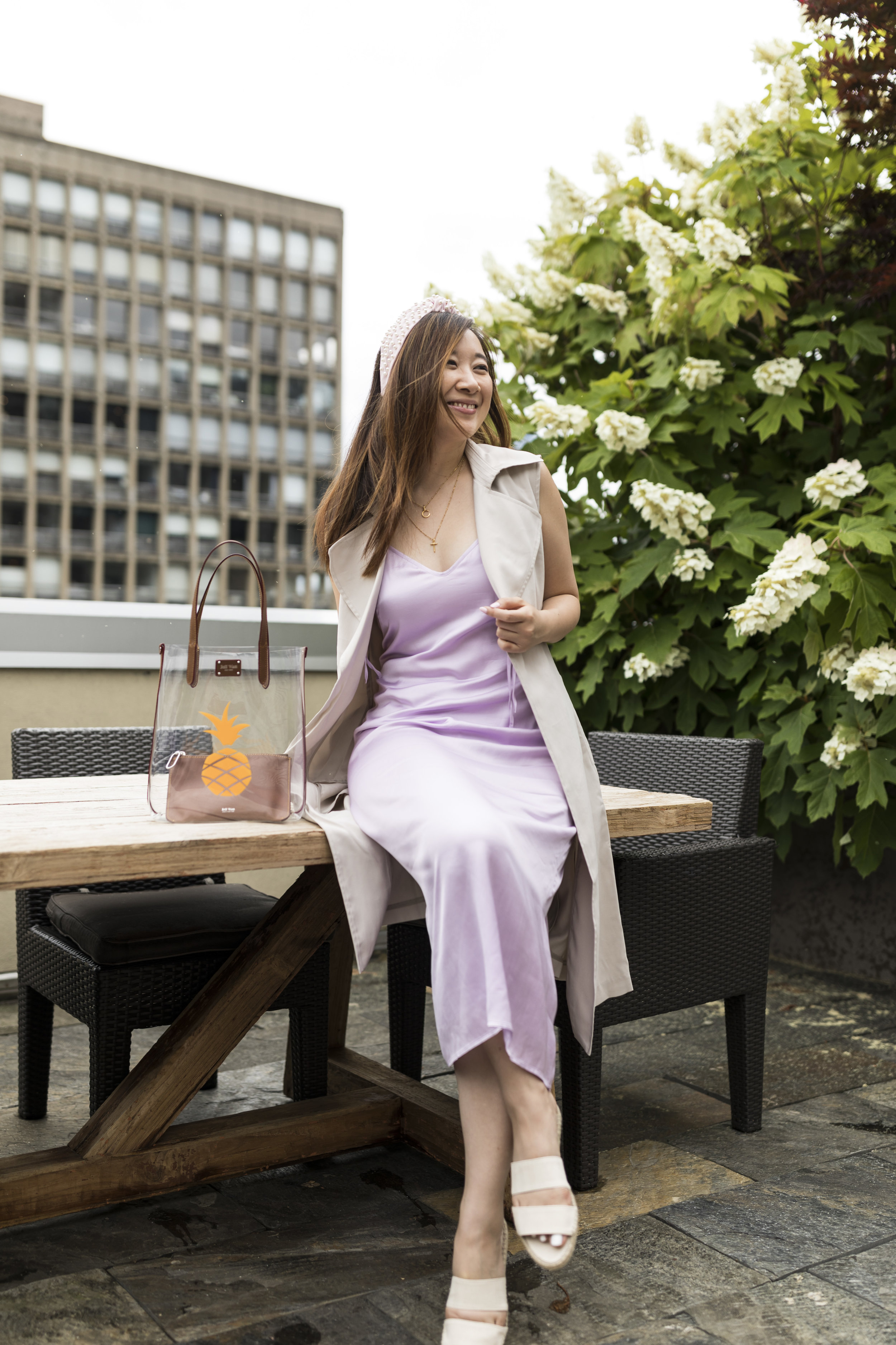 Ready for a Rooftop Picnic - One of my husband's favorite summer activities is to go for a picnic, whether it is in the park, by the water or on a rooftop!This casual weekend outfit features a maxi vest, flat sandals from Mint and Rose, as well as a clear tote by Jeff Wan.Photo by Ashley Gallerani Photography.