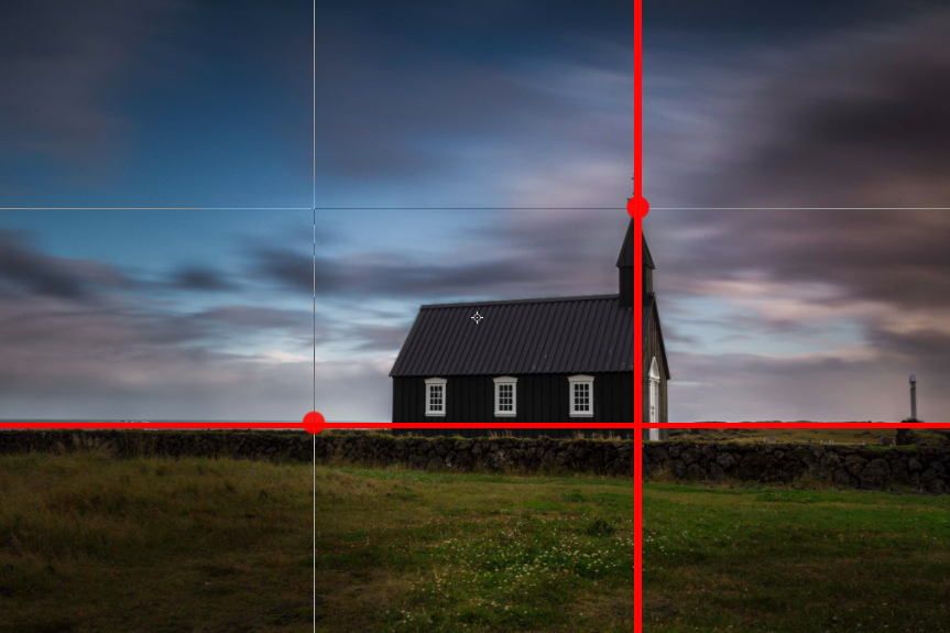 Notice how the church and the horizon are both aligned within the rule of thirds.