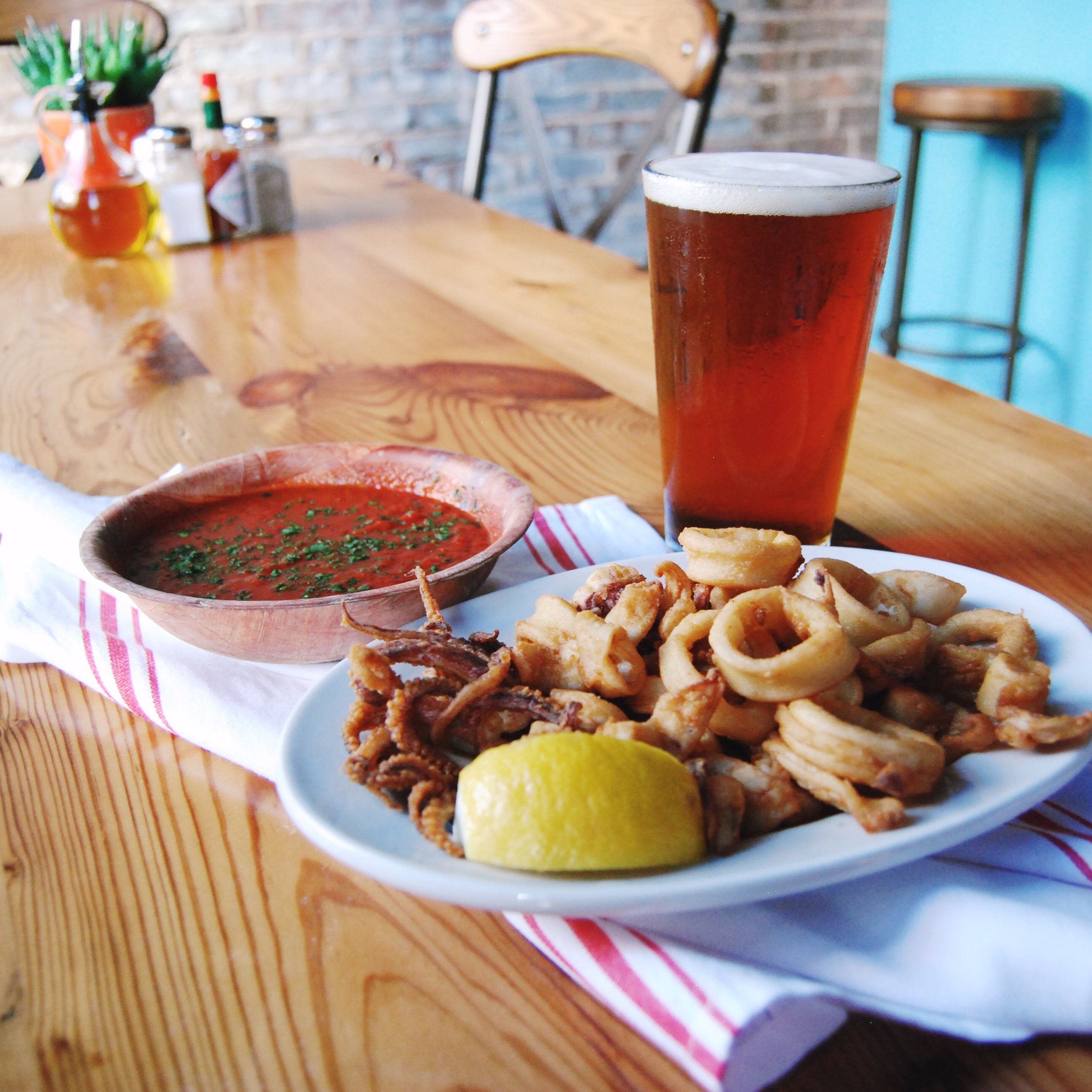 FRIED CALAMARI w/MARINARA SAUCE   Our fresh, local calamari is hand cut in house and lightly breaded. Paired with our signature marinara sauce which gets its rich flavor from lobster bodies, our fried calamari is unlike any you've had before.
