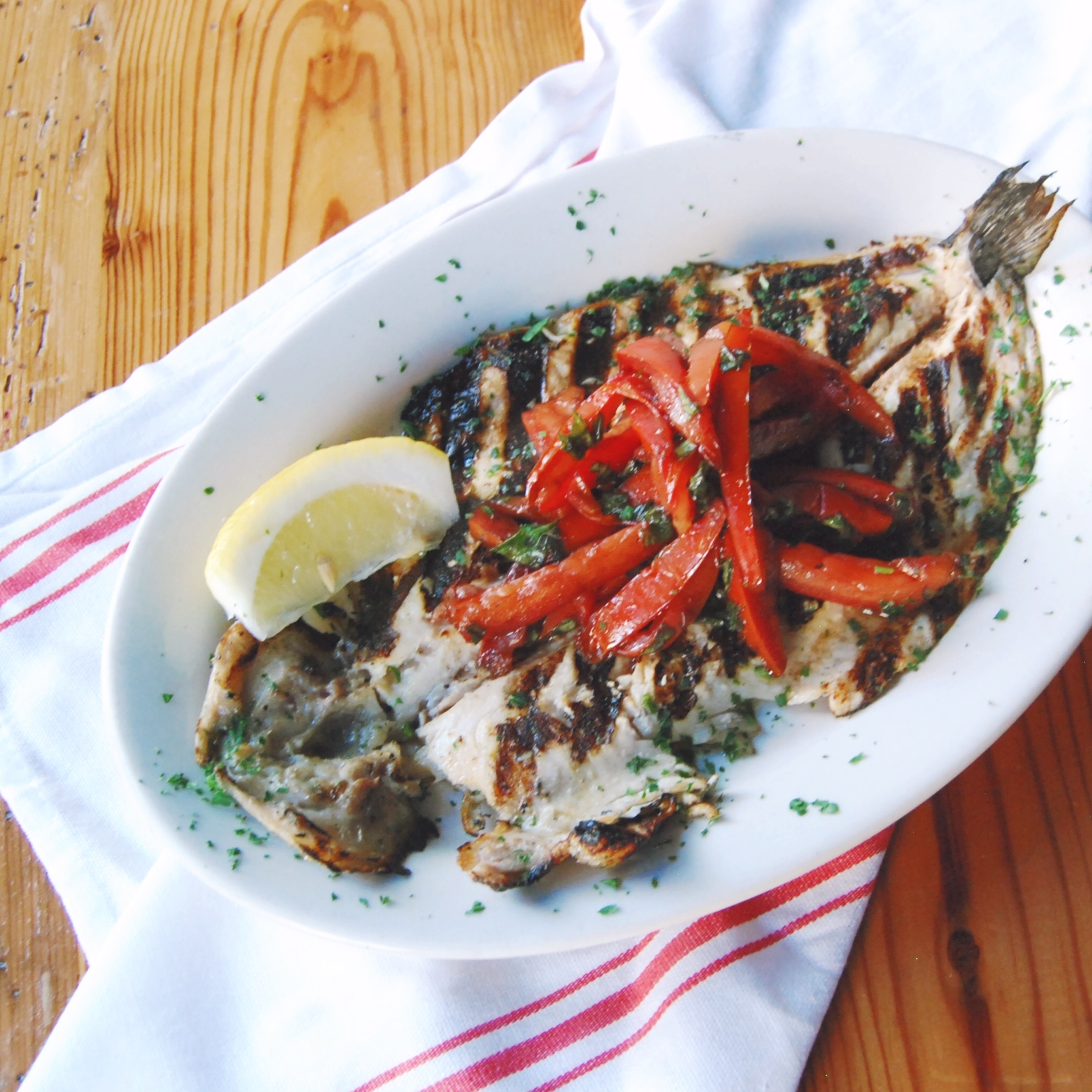 GRILLED RAINBOW TROUT   You won't find fish that's heavily breaded or smothered in sauce here. In a true testament to the quality of our seafood, we cook our fish on a hardwood grill to bring out their natural flavors instead of covering them up.
