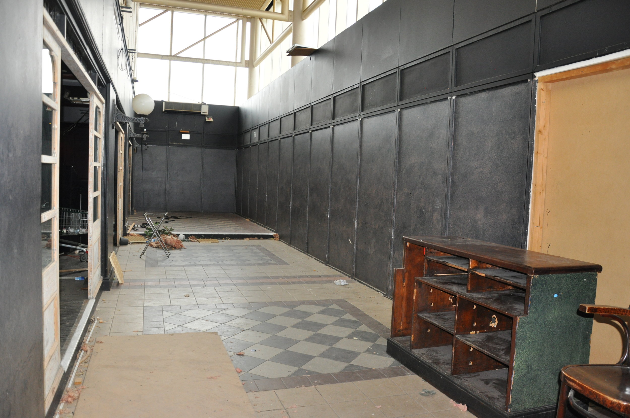 Before | left wall will be removed to open up the space for café tables