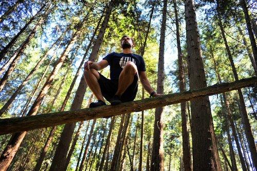 outdoor-man-squat-log.jpeg