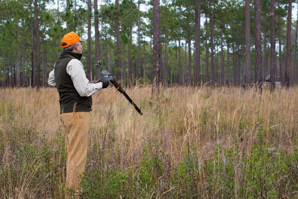Shadow-Oak-Plantation-Hunter-loading-shotgun.jpg