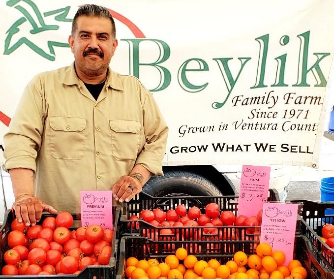 Sebastian hosting our booth at the South Pasadena Farmer's Market.