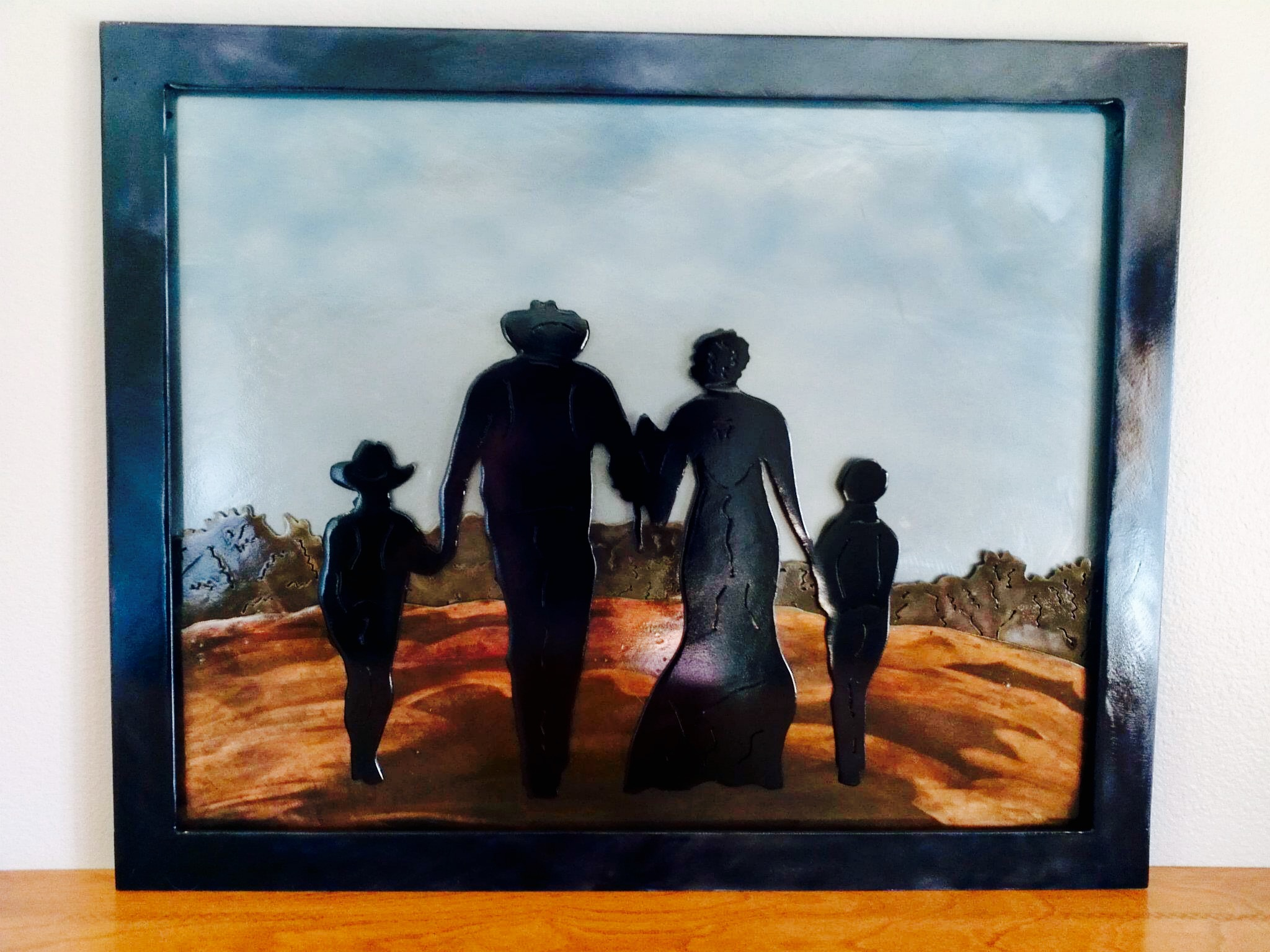 Layered sheet metal silhouette pictures. Various patinas used for affect.