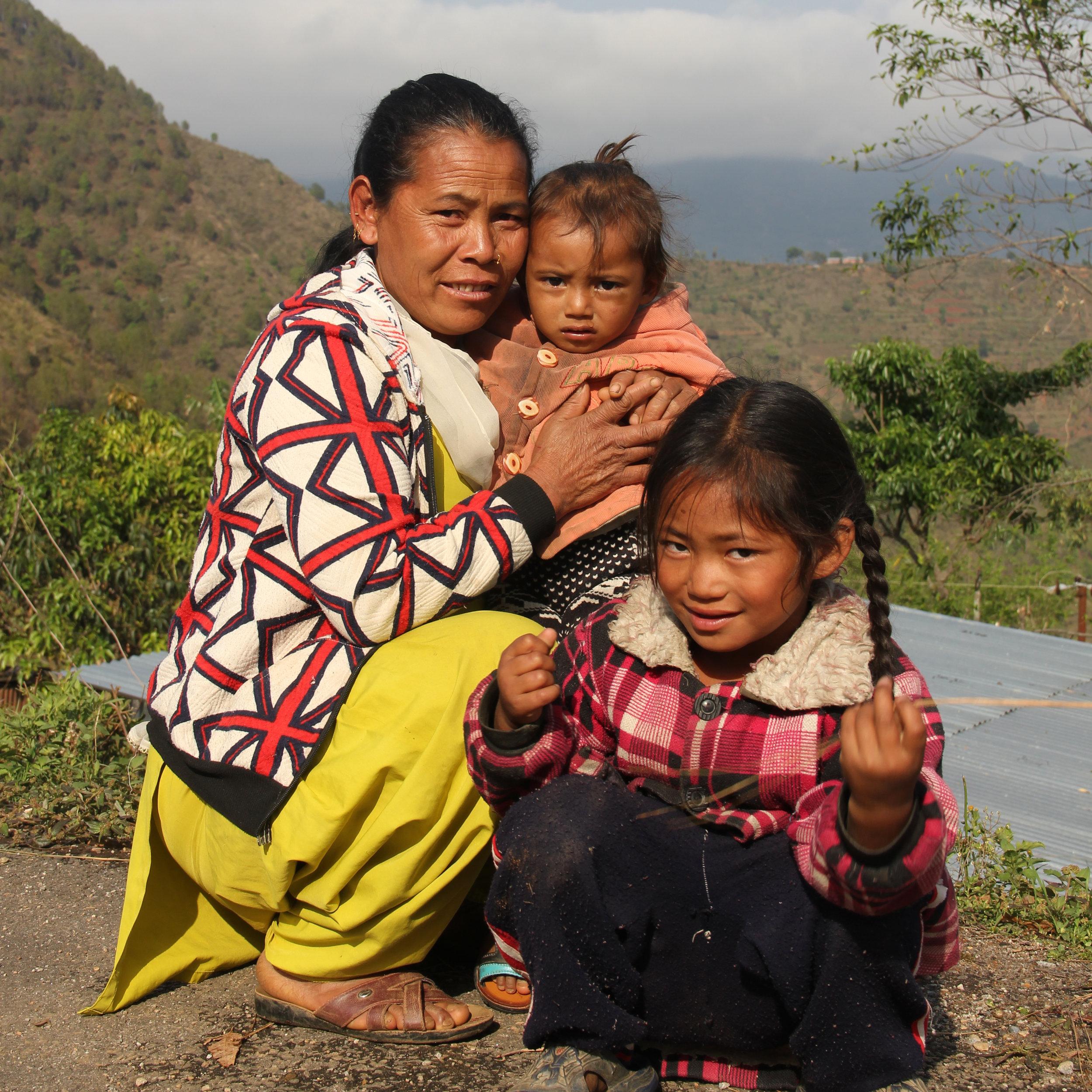 Chinimaya Tamang, 45 with her two kids.