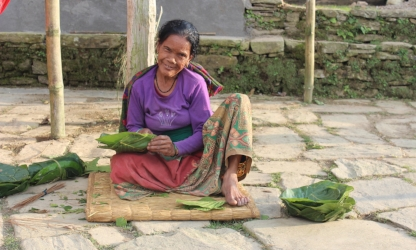Bimala Gurung, a formerly homeless widow, makes leaf plates for the many guests that now visit Rainaskot.