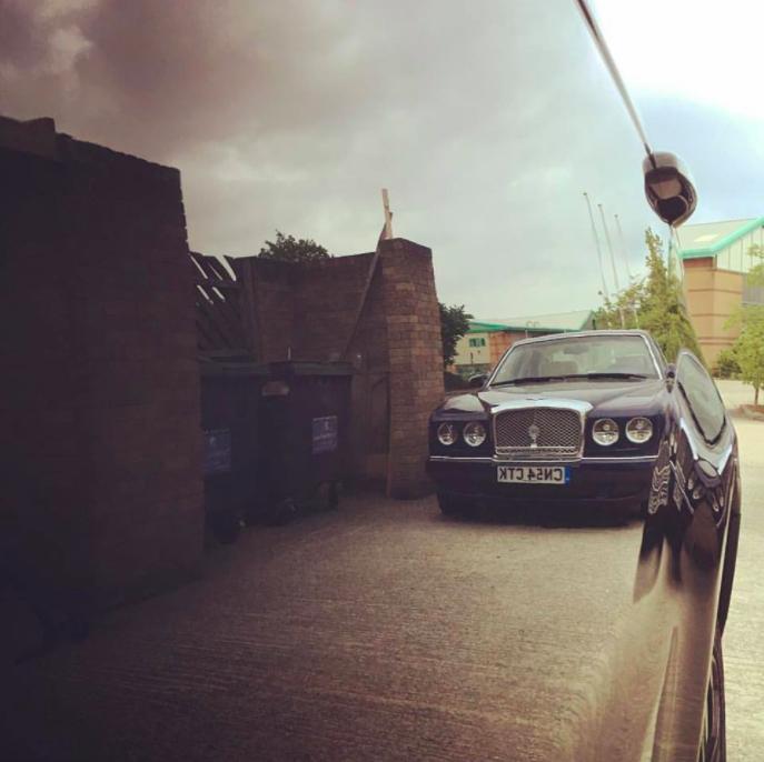 A stunning mirror finish on this Range Rover door panel, in Santorini Black -
