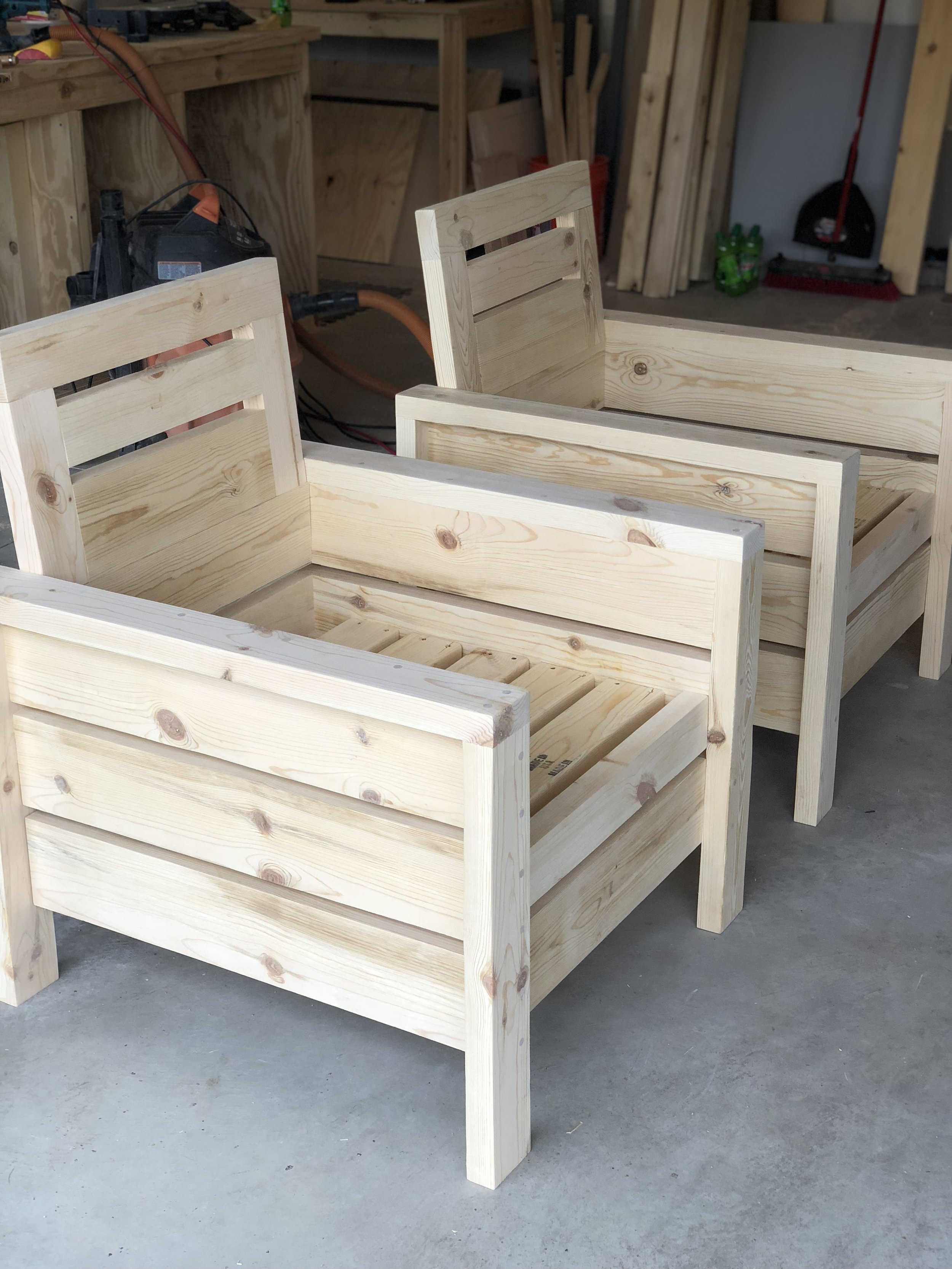 Here are the chairs before I stained them. The simple design and clean lines made these the perfect choice for our front porch. With a per chair cost of $30 in building material, $60 in cushions and $10 in stain we were able to achieve the look of a much more expensive chair.