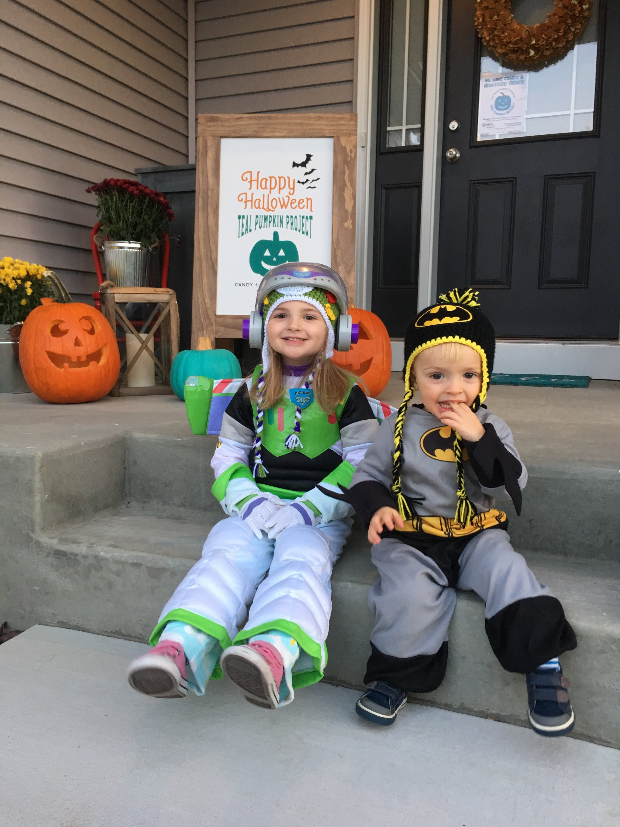 Buzz Lightyear and Batman all ready for some Teal Pumpkin Trick-or-Treating