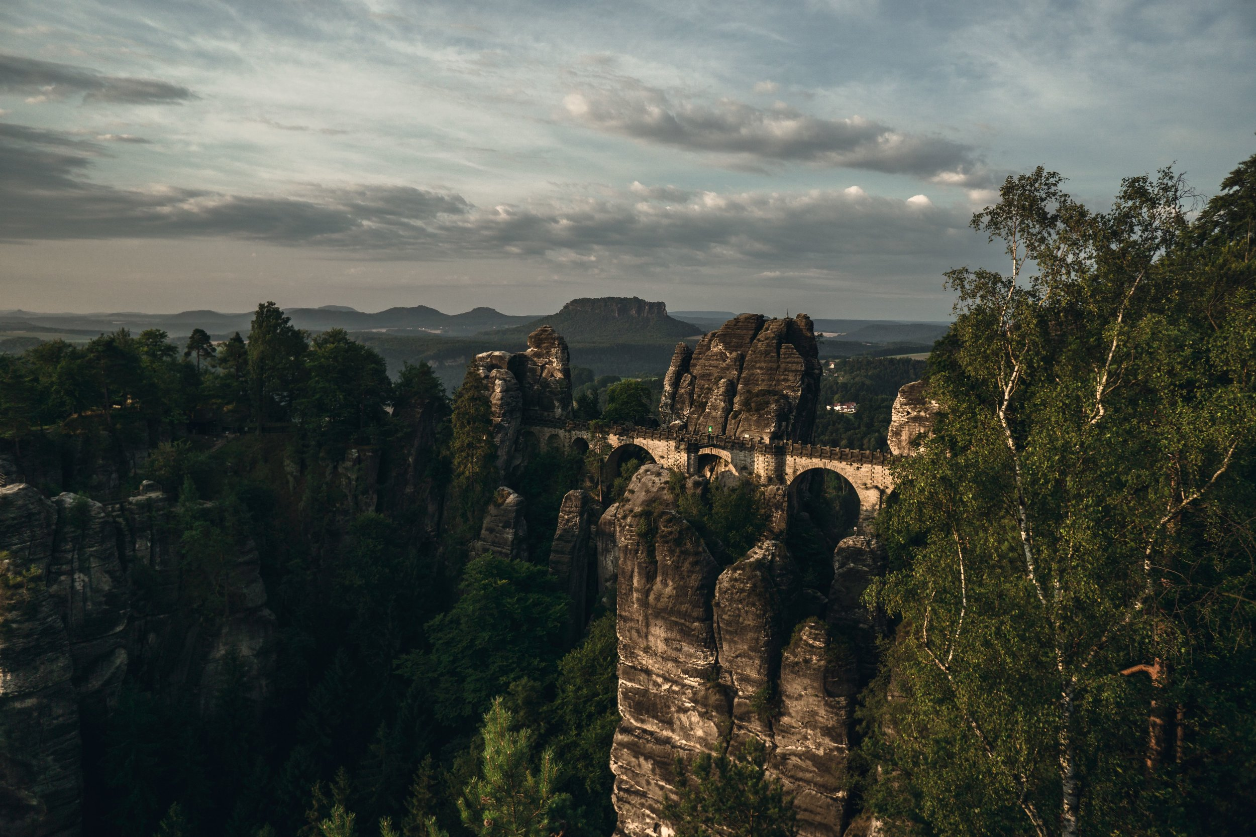 That is the Bastei, which is a formation of rocks with a bridge built in in a height of 194 about the ground. Shot with the Sony Alpha 6000 and a Sony 16mm 2.8 lens.