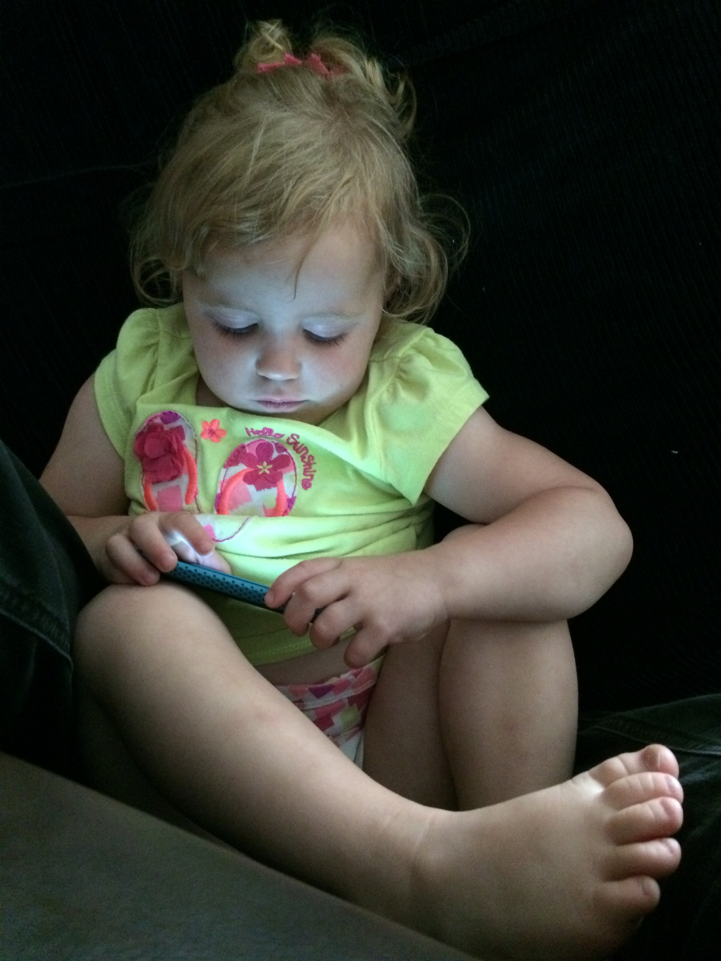 Granddaughter on her iPod Touch (older pic)