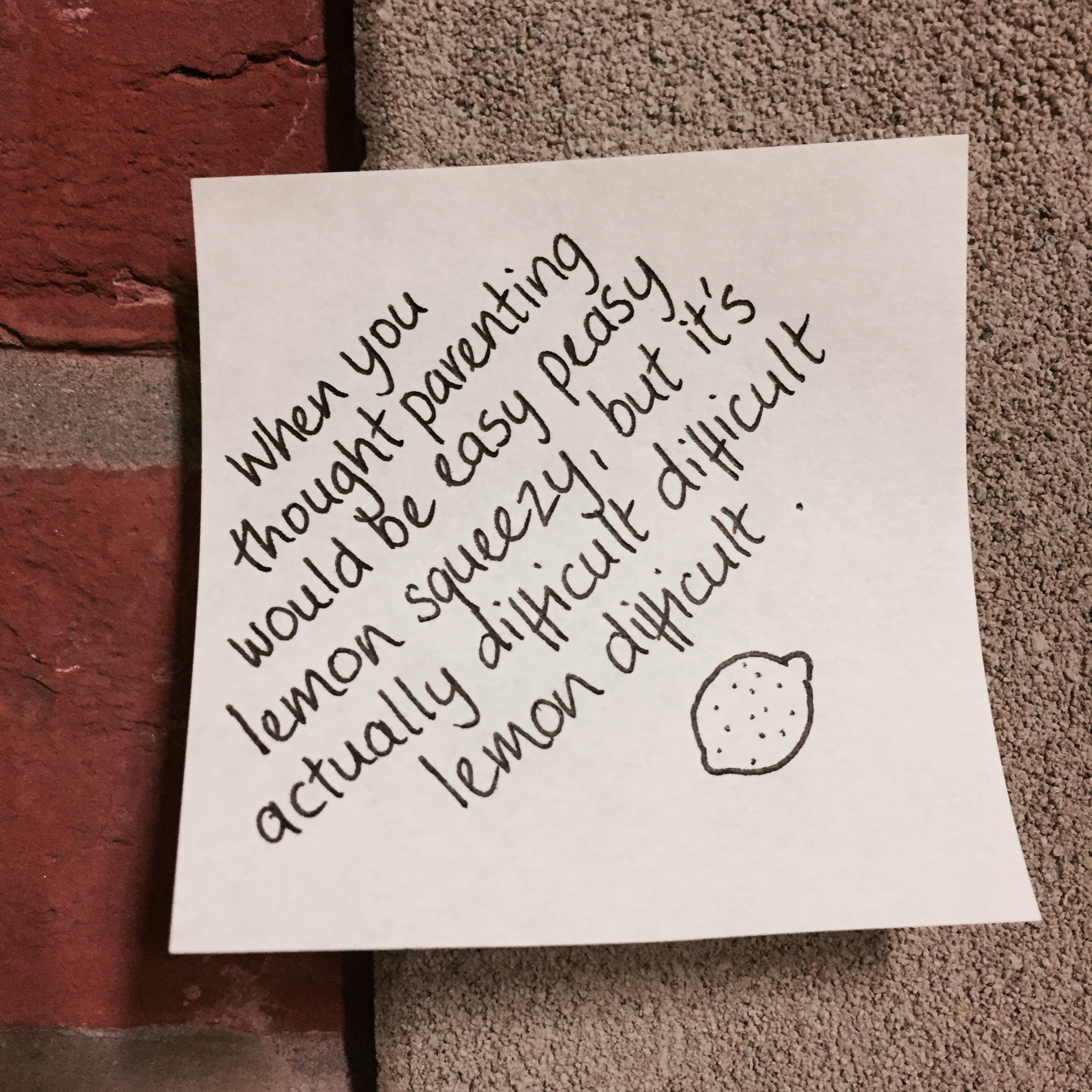 A post-it note on a brick wall.jpg