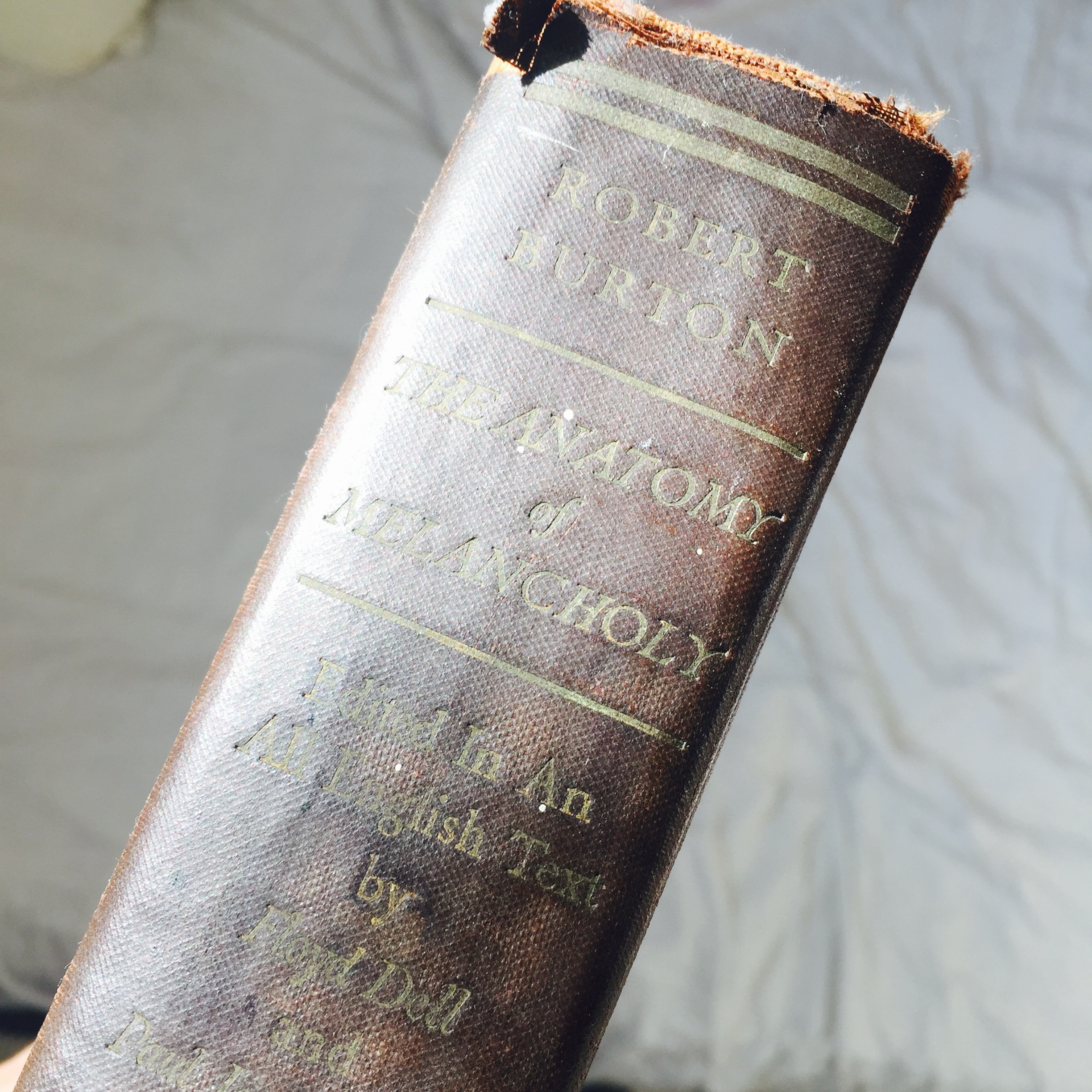 A close up of the spine of Robert Burton's Anatomy of Melancholy book.jpg