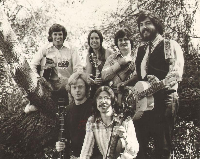 Kate Wolf with the Wildwood Flower. Left to right: Rick Byars, Blair Hardman, Rick Ellis, Don Coffin, Eddie B. Barlow