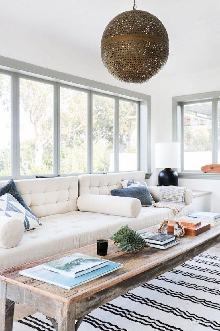 A Malibu farmhouse's comfy neutral sunroom,  via My Domaine.