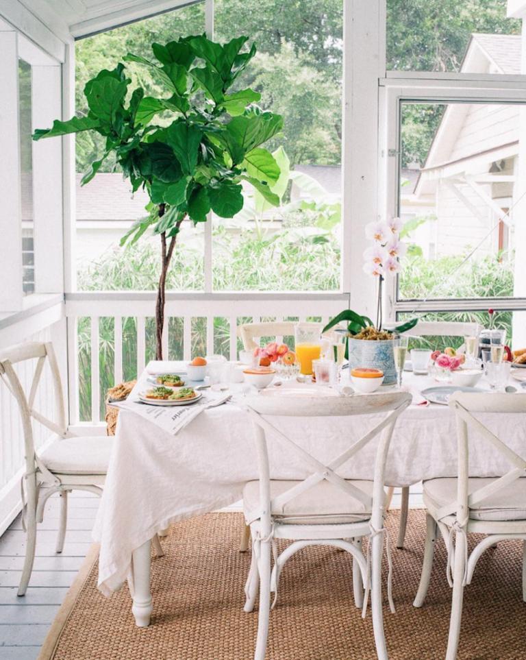 Bright white cheery breakfast nook,  via Lucy Cunero.