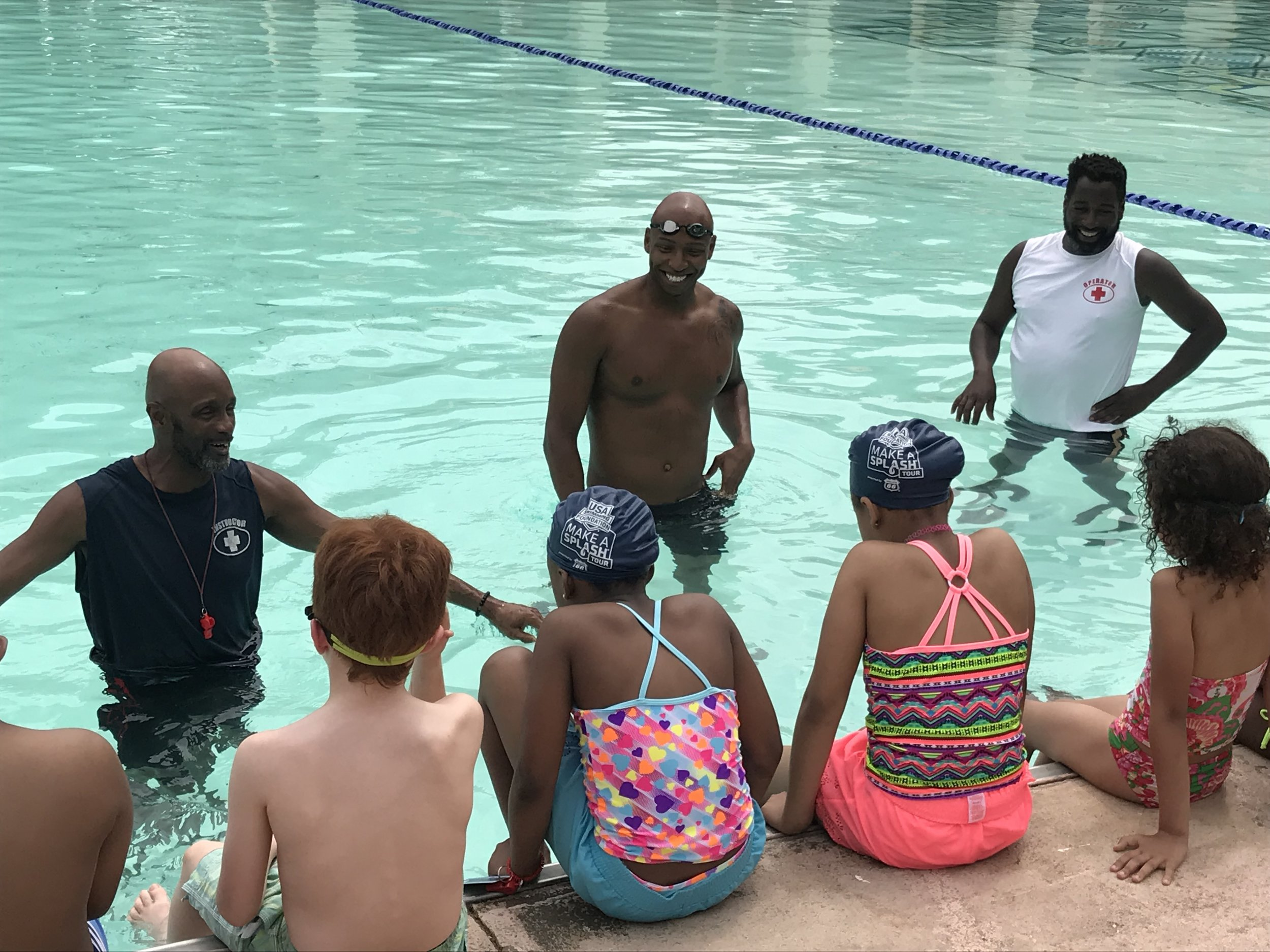 Cullen Jones (middle) assisting Baltimore Recreation and Parks staff with swim instructions. Photo by Aspen Institute Sports & Society Program