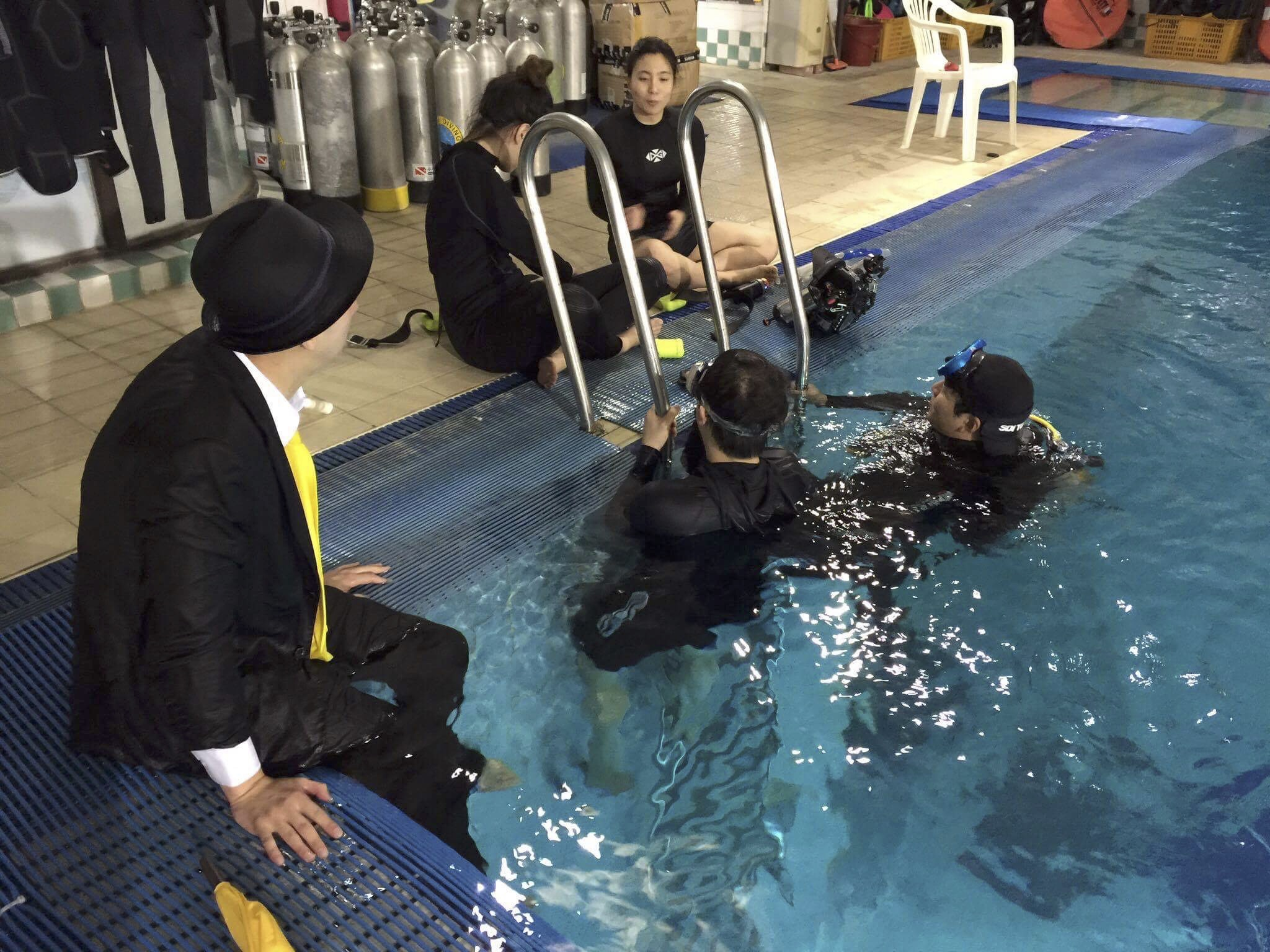 YZin and Hoon teach students how to model and do UW photography as well as snorkelling