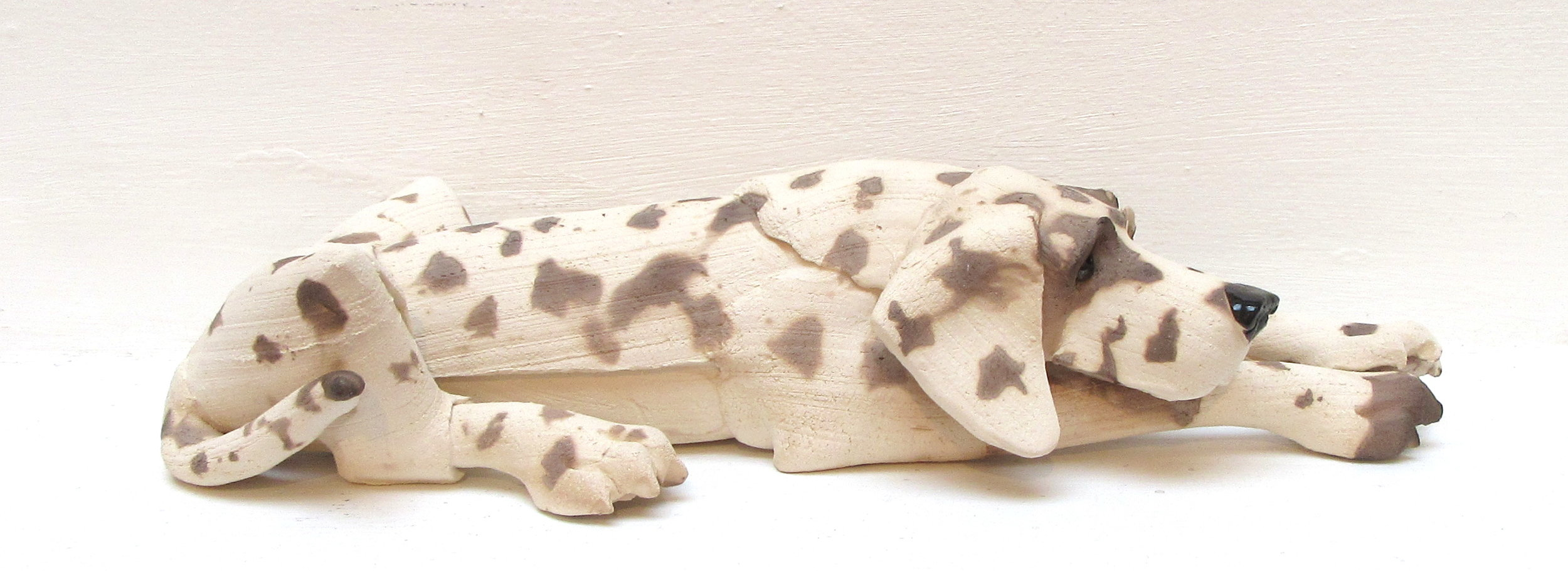 Small Spotted Lying Dog