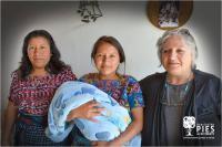 Left to Right: Silvia, PIES Health Educator; Patricia Oxlaj and son; Horizons ED Patricia Rebolledo